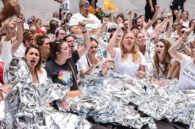 """On June 28th, 2018 protesters take over the Hart building on Capitol Hill to the cries of """"We care"""" and """"Abolish ICE"""". Protesters covered themselves with Mylar blankets, similar to the ones given to immigrants in detention centers, to bring attention to the administration's change of policy which has led to family separation at the border. In total, close to 600 protesters, mostly women, were arrested.  #DC #WashingtonDC #protest #OnAssignment #photojournalism #NotASwamp #bythings #women #immigration #Trump #congress #CapitolHill #politics #protest #canon #notiphone #news"""