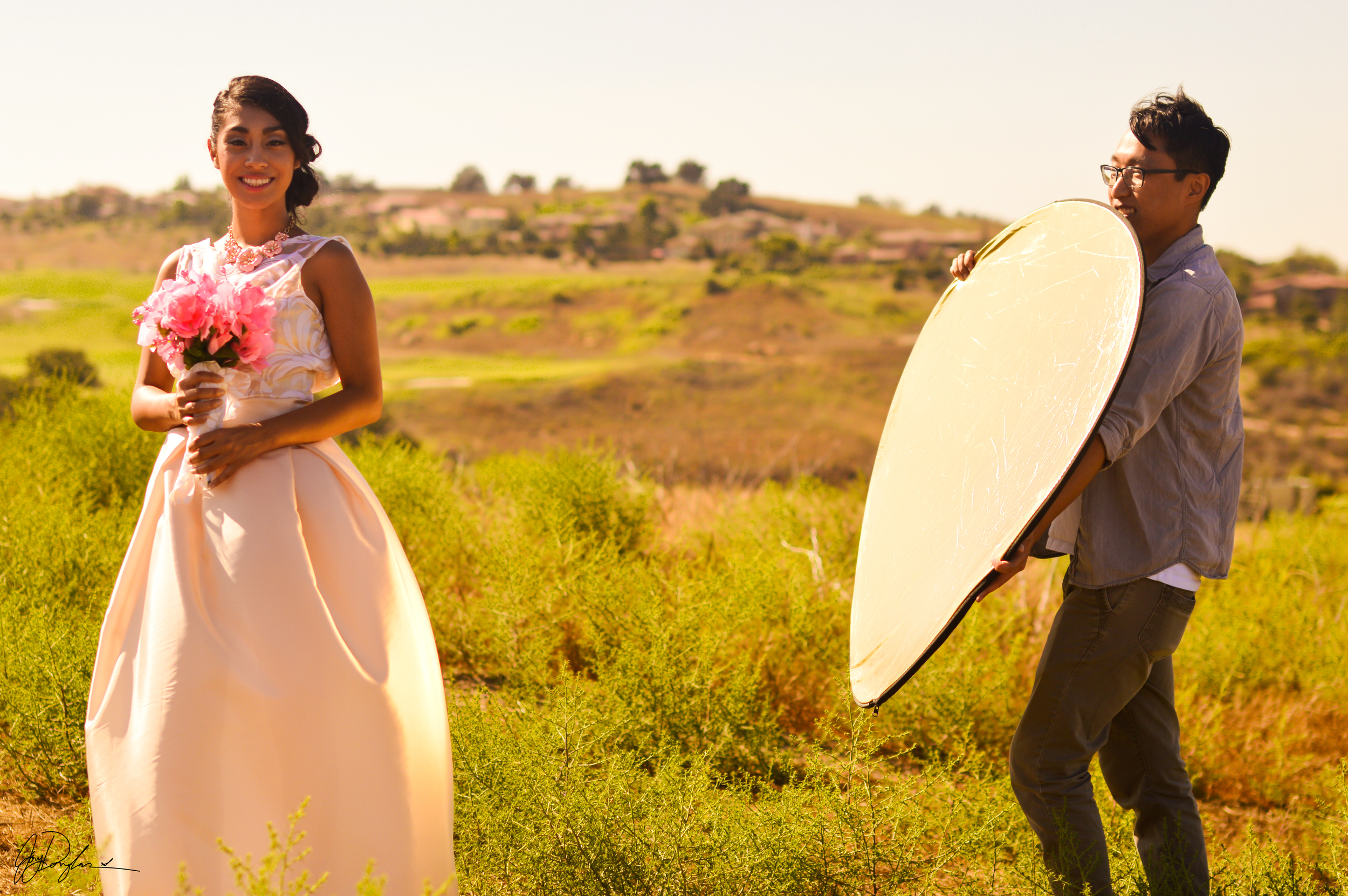 Model Yolanda Panuco and lighting assistant Darren Dai during an afternoon fashion wedding shoot. Chino Hills, California
