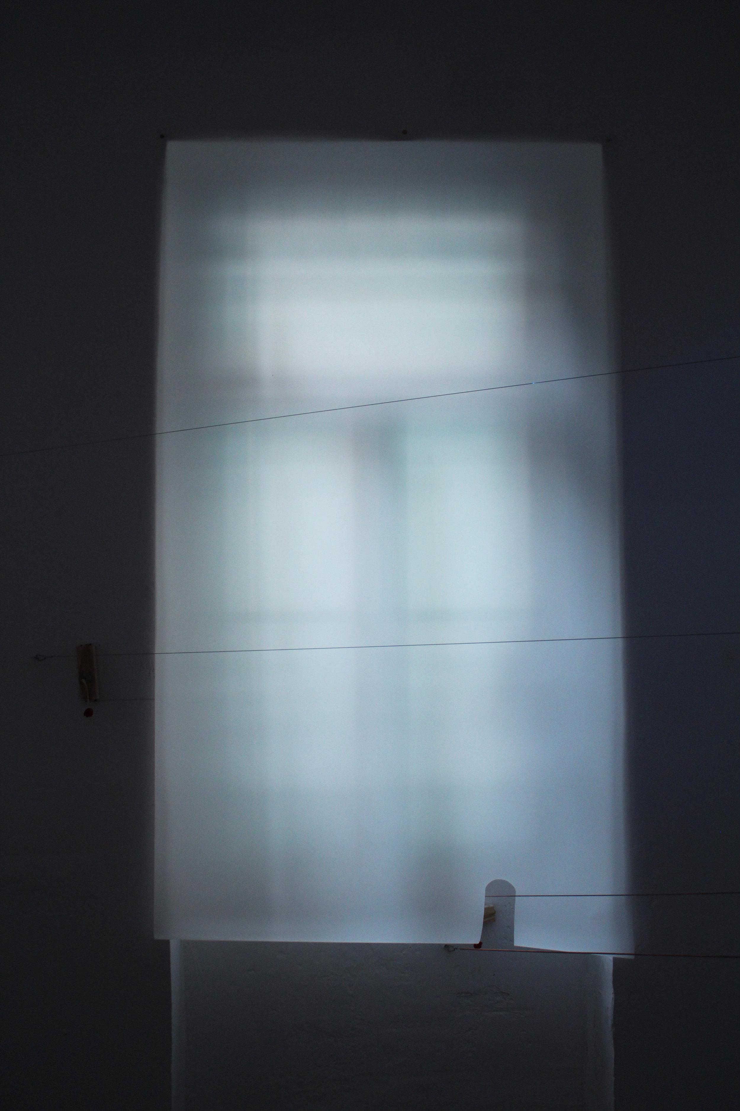 Detail of installation room 1. Piano strings, motors, motion sensors, light diffusion paper.