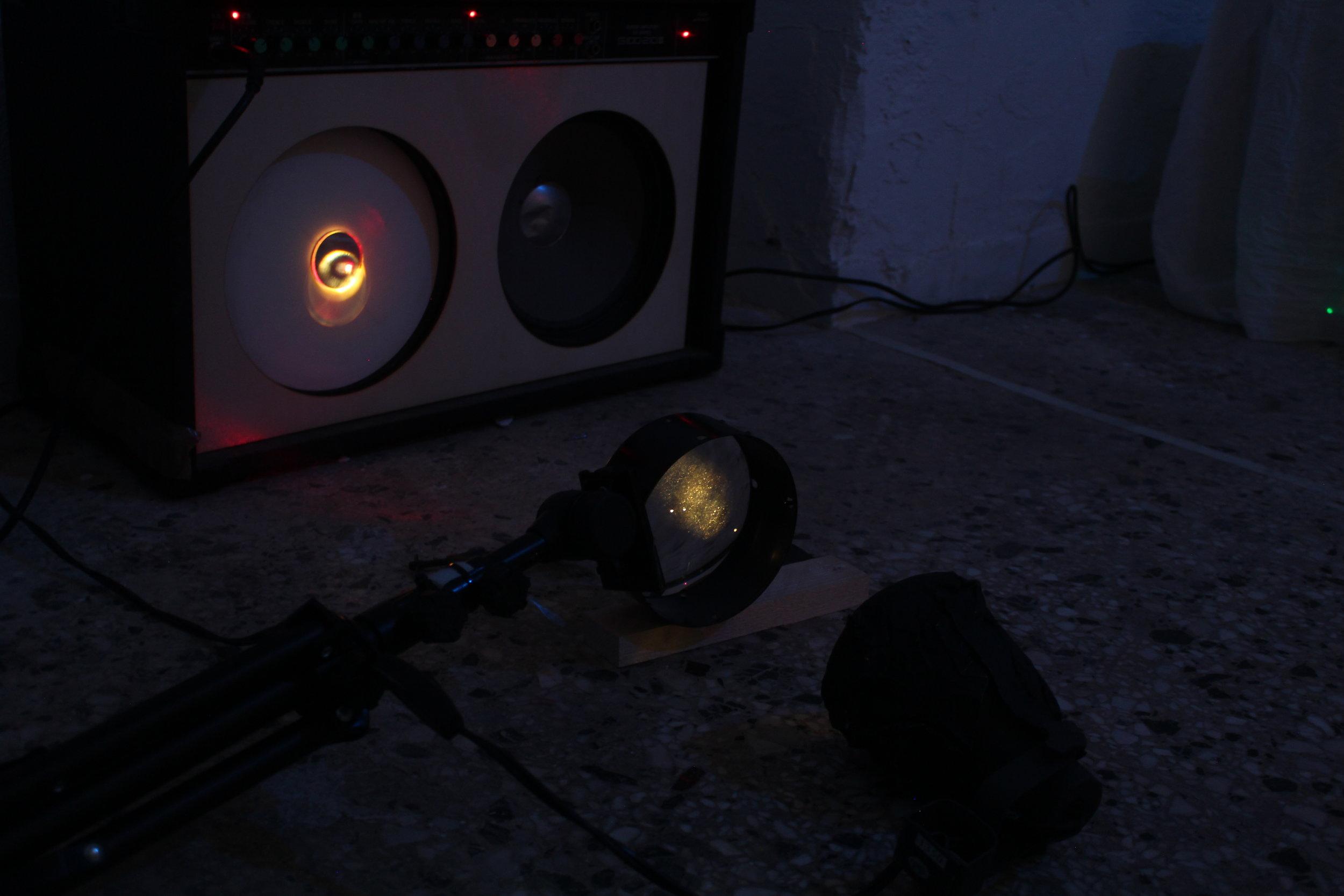 Detail of installation room 2. Guitar amplifier,mirror,balloon, laser, LED light, enlarger lens.