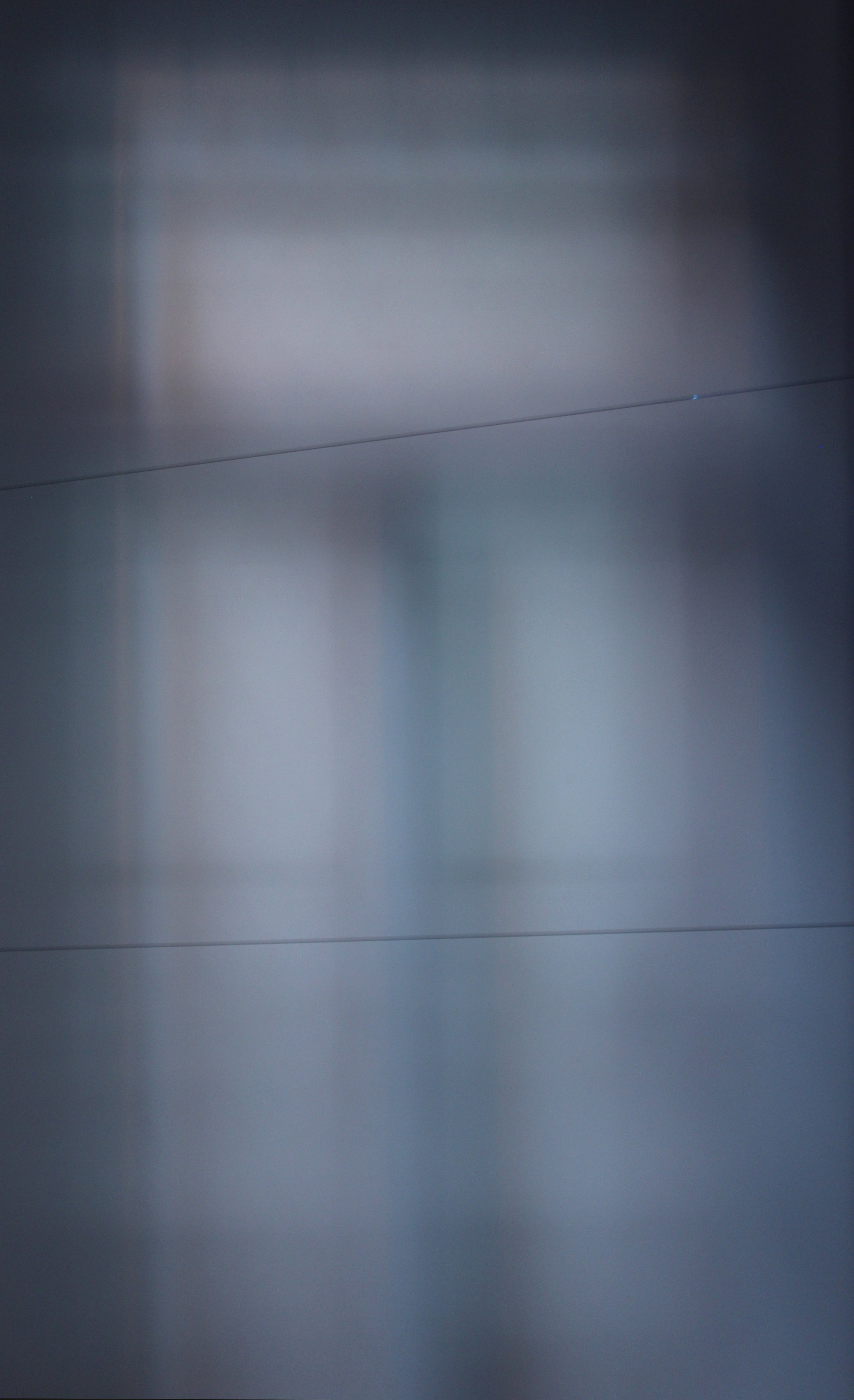 Detail of installation room 1. Piano strings across light diffusion paper. Afternoon light.