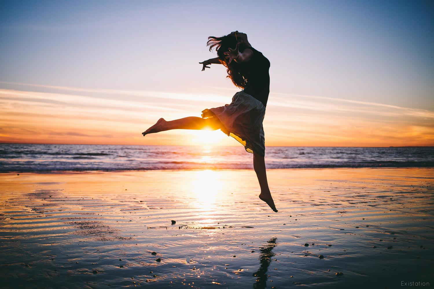 dancing+silhouette+sunset+beach+ocean.jpg
