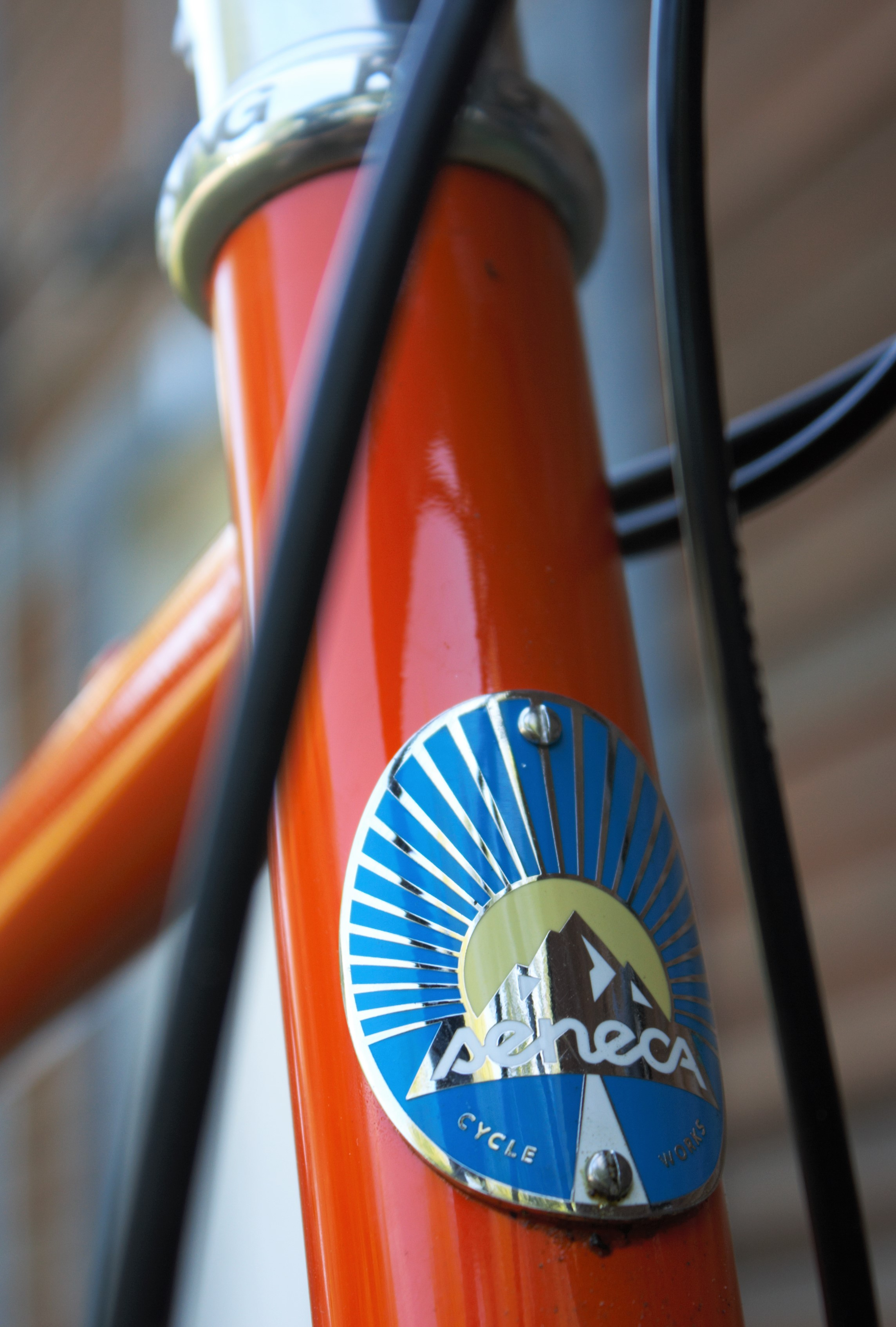 Cast and enameled head badge, standard on all Seneca Cycle Works bicycles.