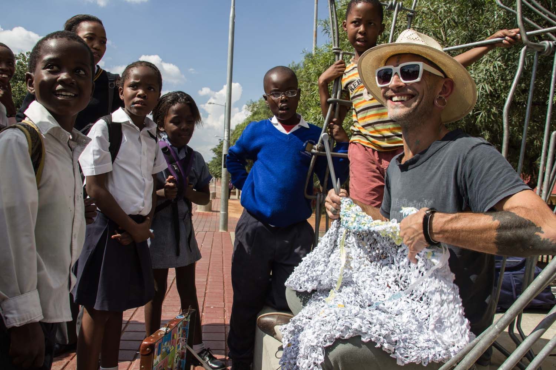 Knitting with 'Student Confrontation' public sculpture by Stone Mabunda, Vilakazi St, Soweto, 27 February 2014, Image- Mark Rautenbach, Photographer- Popskiet