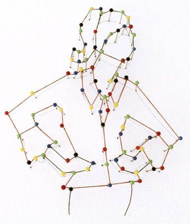 Partial installation:   Pin Girl Fashion, 2011.     Glass head sewing pins and thread on a wall.  Image courtesy of the artist.