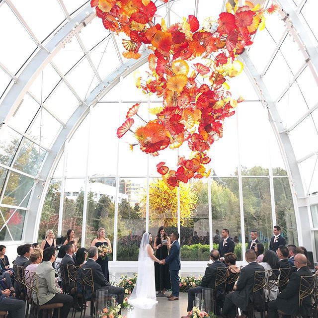 Epic weddings calls for epic ceremony locations!  Venue | @chihulygg  Planning & design | @newcreationswed @ Photography | @charbeckshoots  #goodtimesproductions #chihulygardenandglass #weddingvideography #destinationwedding #seattleweddings #pnweddings #ceremonybackdrop #weddingvideographer