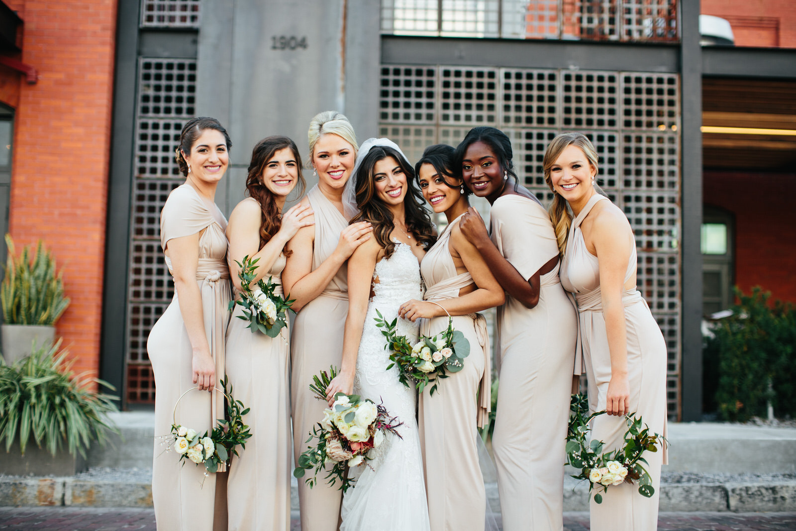 Bridesmaids Together in front of Armature Works Tampa Wedding