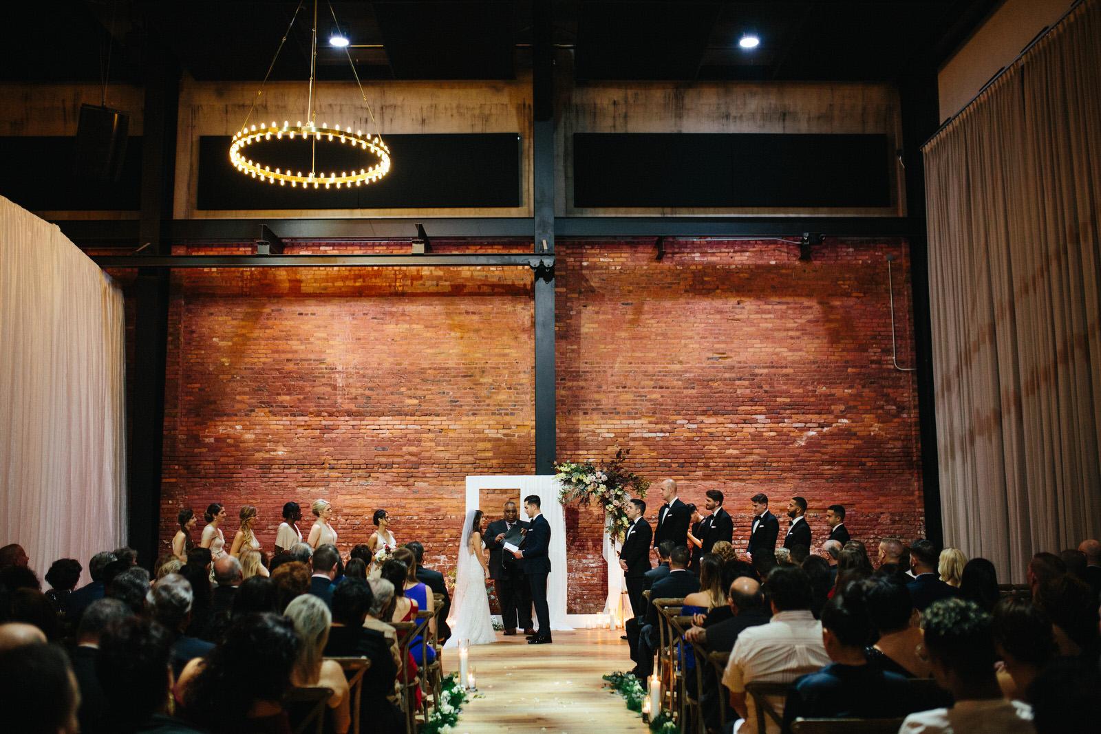 Bride and Groom at Altar Armature Works Wedding