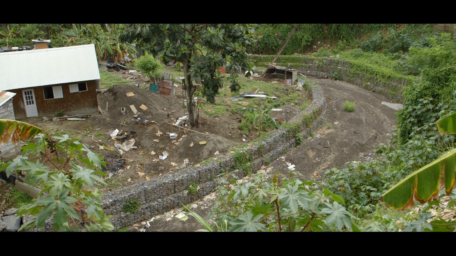 Gabion baskets along the stream slopes