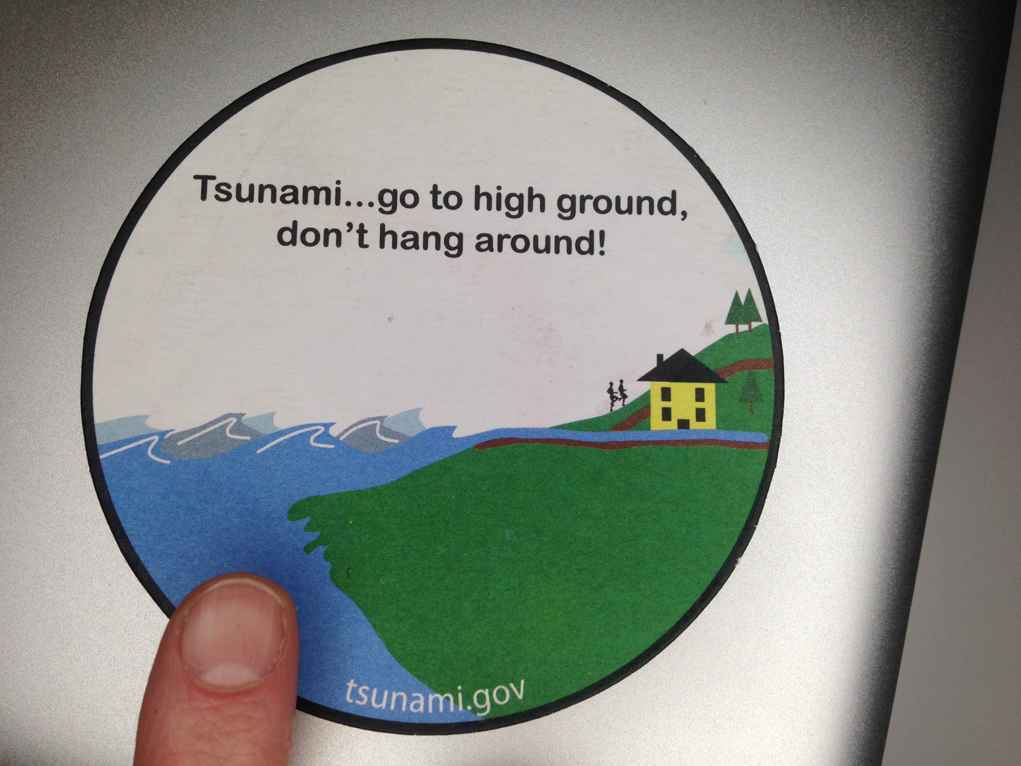 ...and the other side of the coaster. F ound at the  National Emergency Management Organization (NEMO) headquarters.