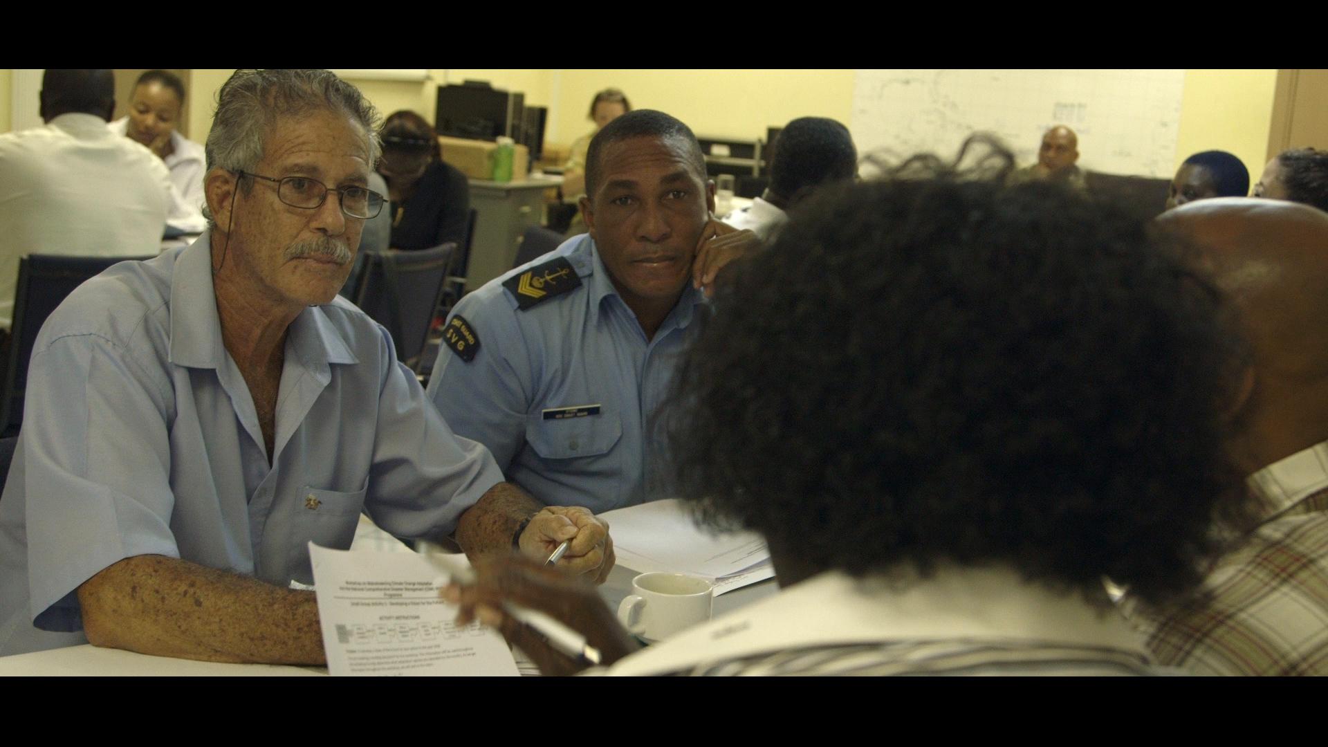 Herman Belmar & Coast Guard CPO Doninique Stowe at CDEMA workshop. - Video Still