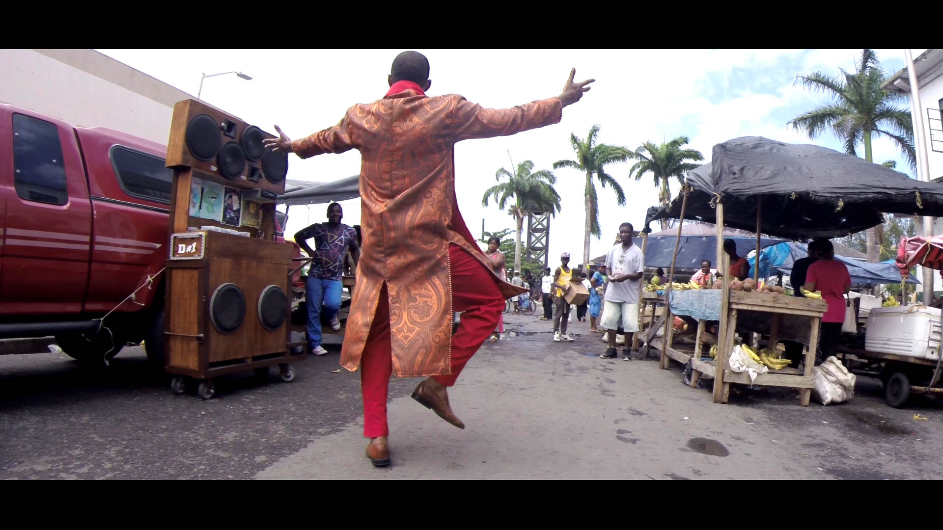 Singer shooting a music video, speakers blasting - Saturday market, Kingstown, SVG - Video Still