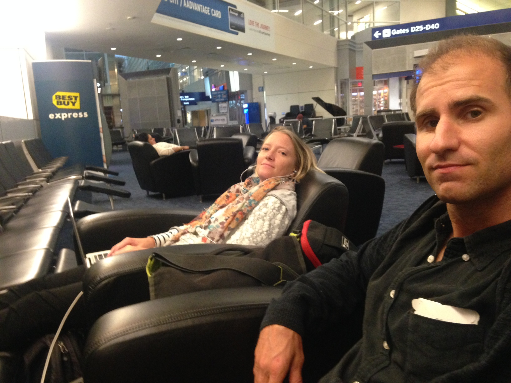Tom and Nuin-Tara, on the way home,  settling in for a night at the Dallas airport  - photo, Tom Miller