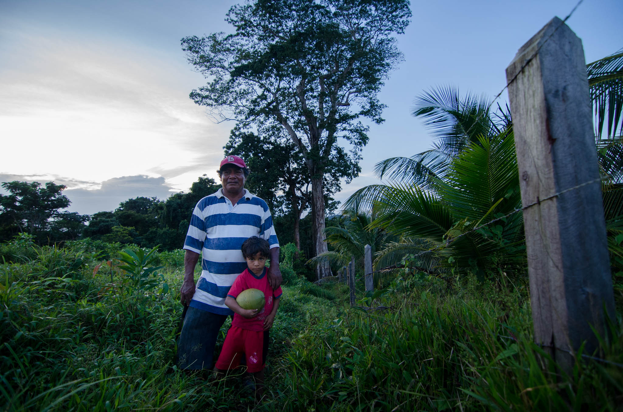 Jimmy and Grandson near his coconut farm, Ebo tree behind them - photo, Tom Miller