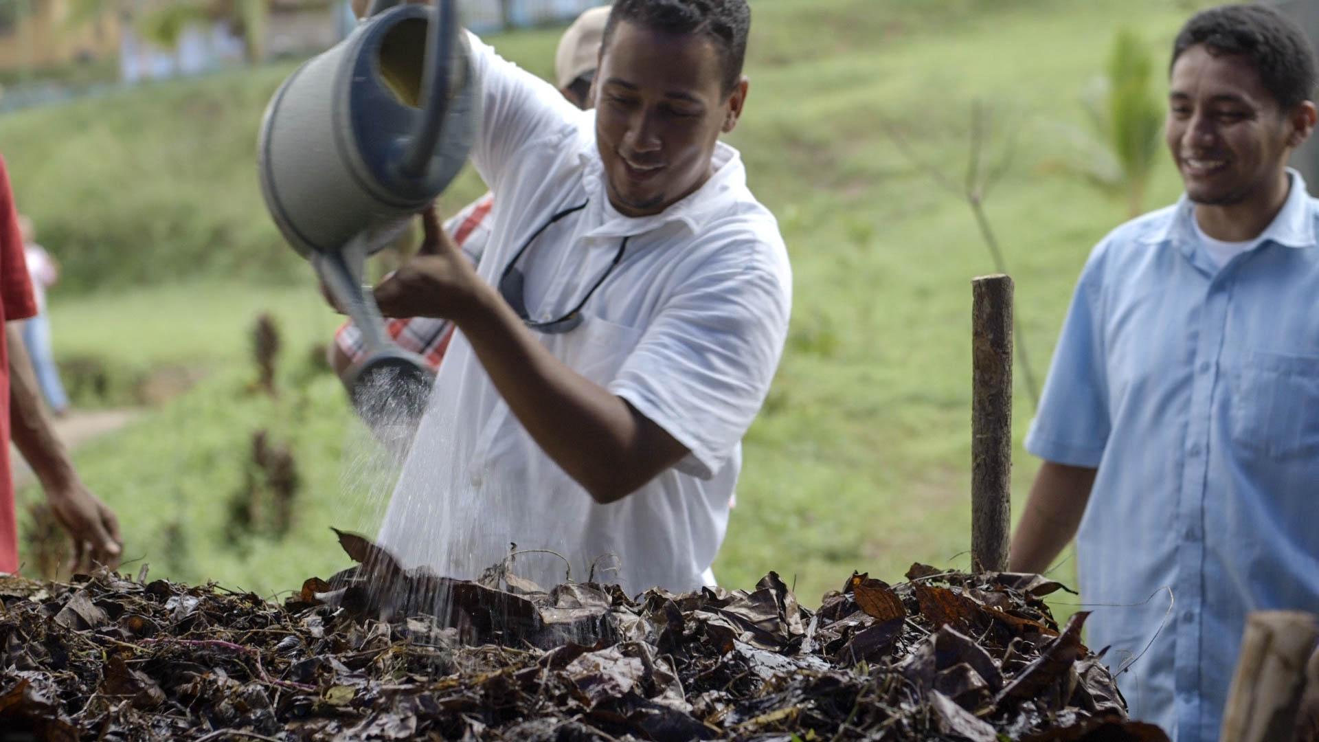 Watering compost, Biointensive training - video still, Tom