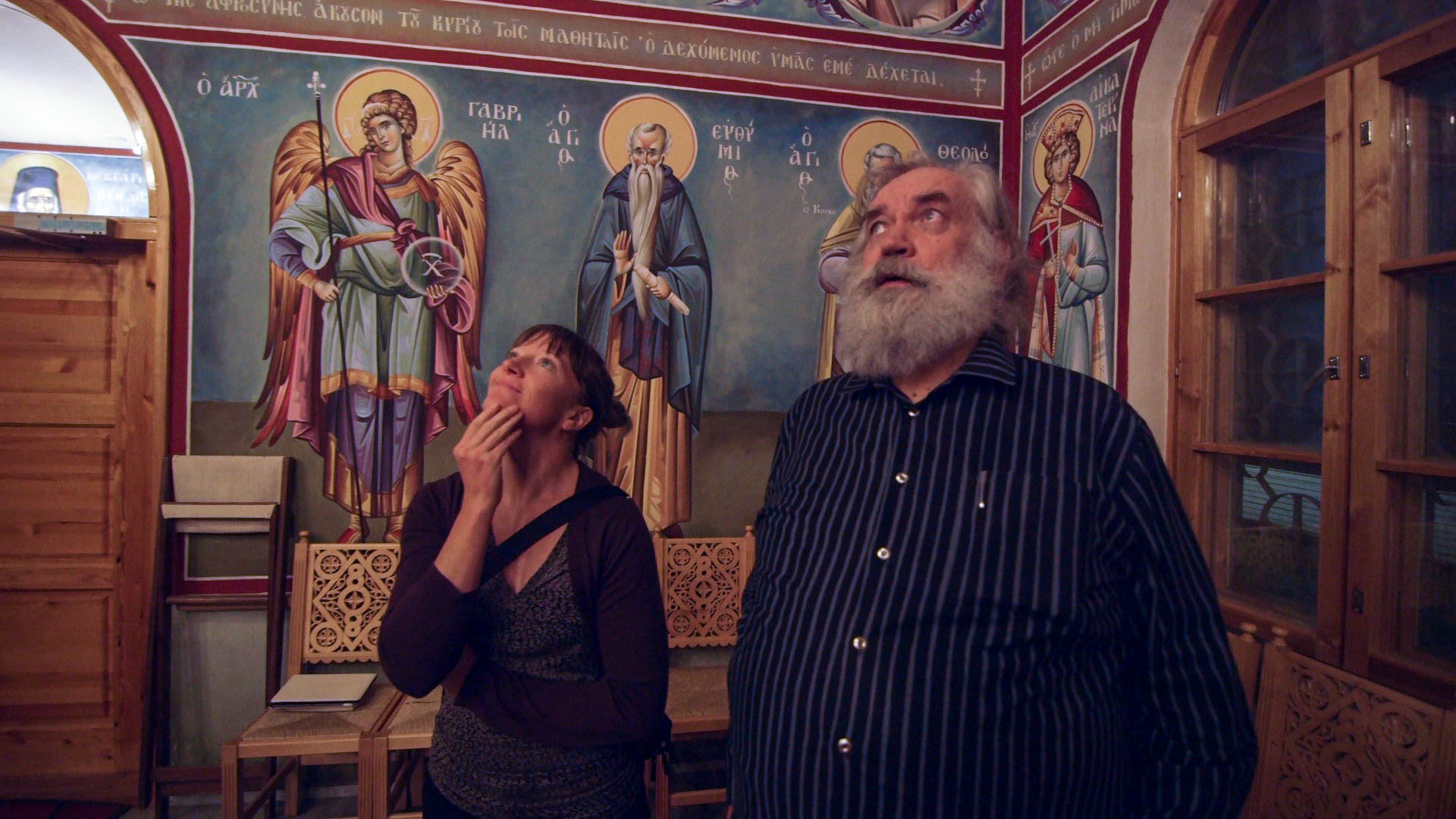 Nuin-Tara and Antero at a Greek Orthodox church he designed, Joensuu, Finland - video still, Tom Miller