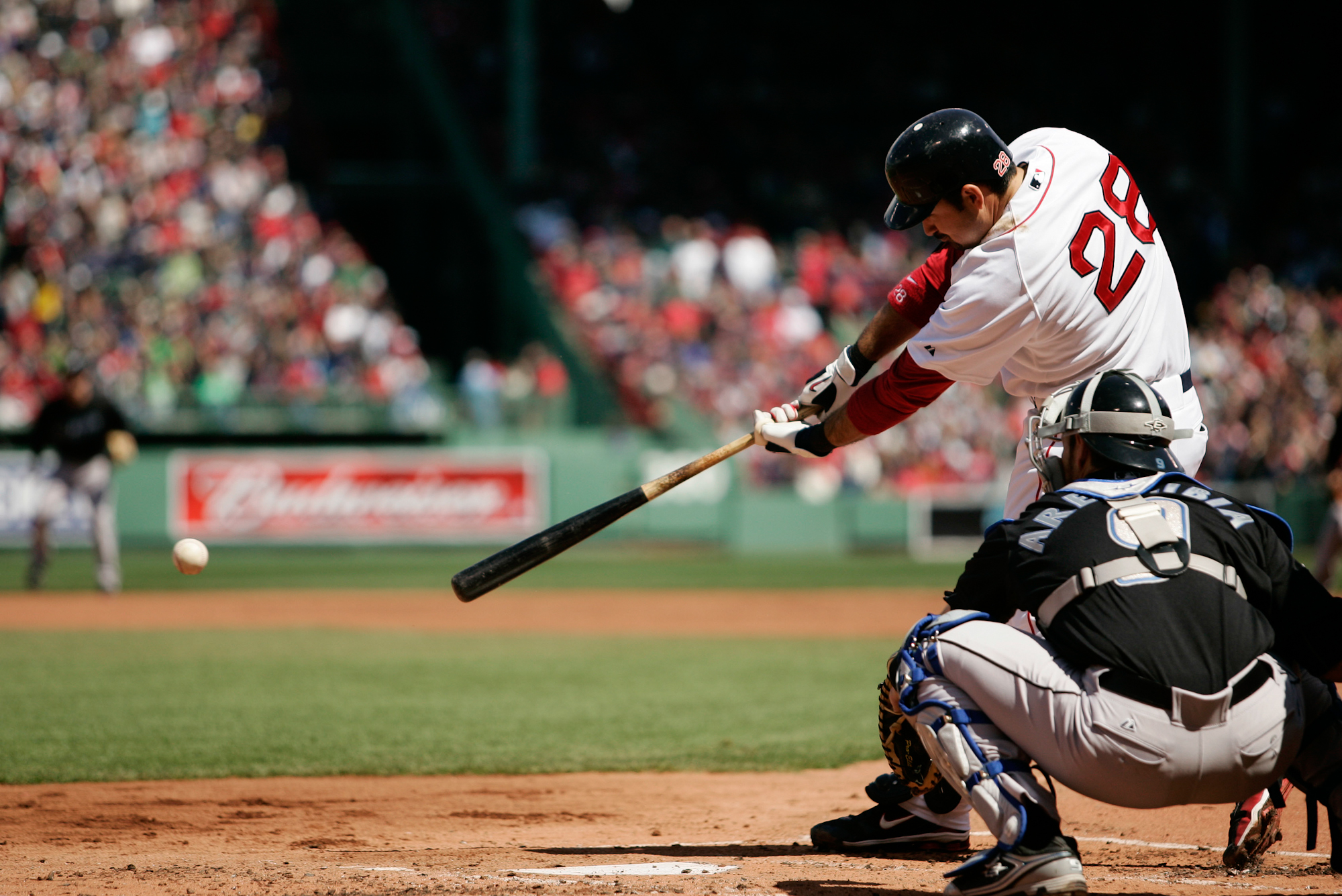 Boston Red Sox Adrian Gonzalez connects for a single in the first inning against the Toronto Blue Jays at Fenway Park in Boston on April 17, 2011.