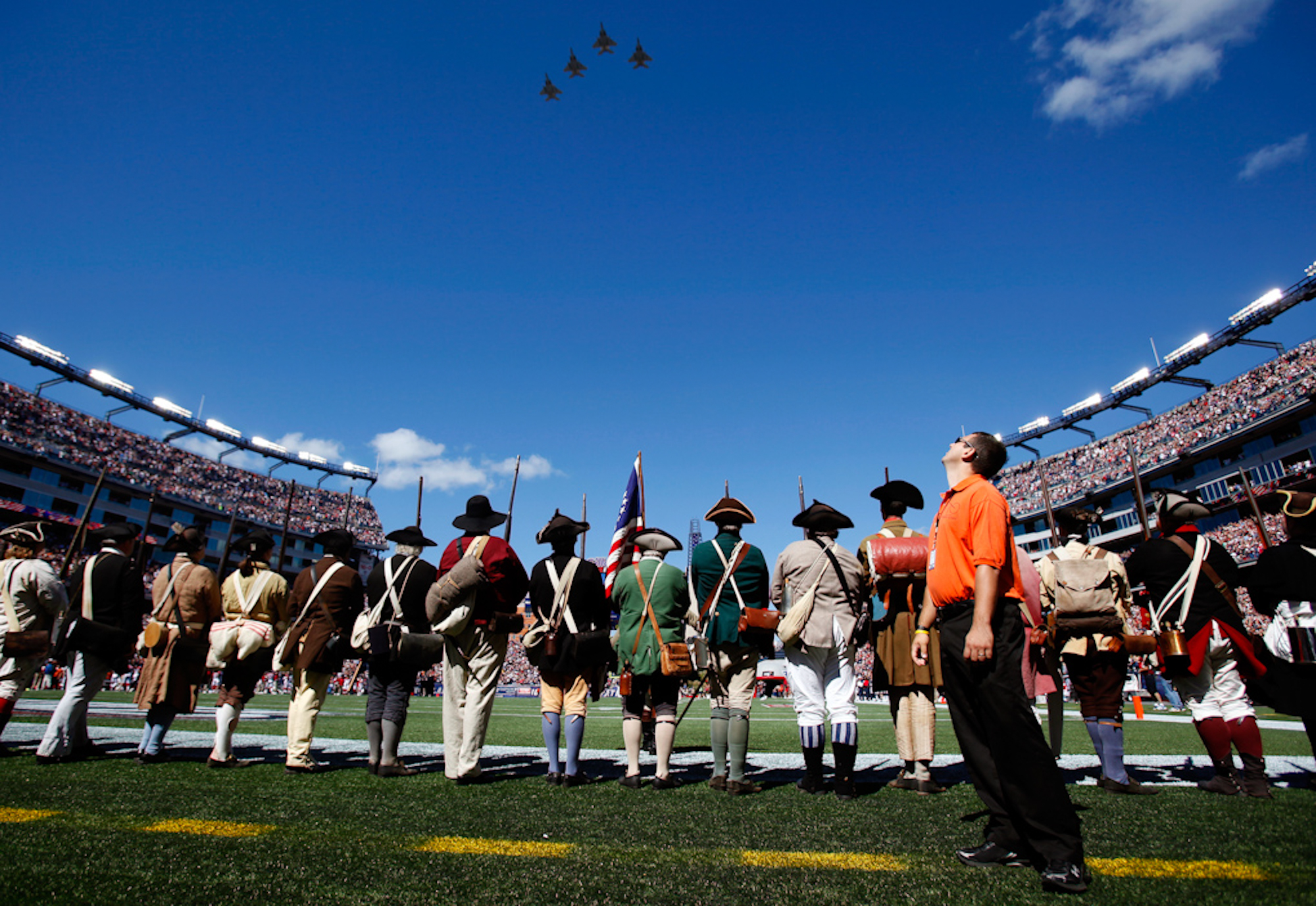A Gillette Stadium security detail watches jets flown by the Massachusetts Air National Guard as they perform a fly over of the stadium before the game between the Arizona Cardinals and New England Patriots in Foxboro, Massachusetts on September 16, 2012. The Cardinals defeated the Patriots 20-18.