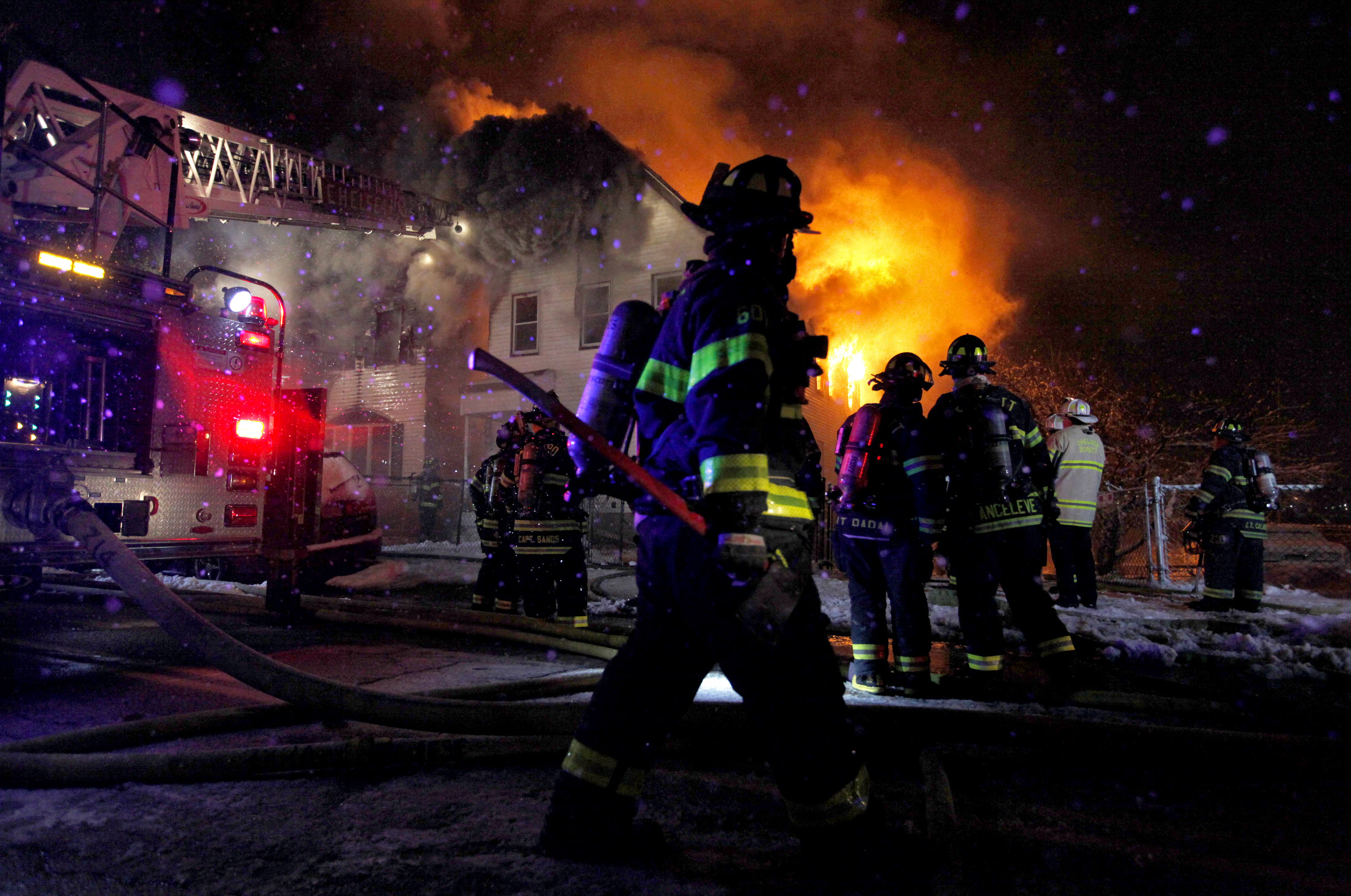 Chelsea firefighters battle a blaze at 375 and 373 Crescent Avenue in Chelsea, Massachusetts on Saturday, January 24, 2015.