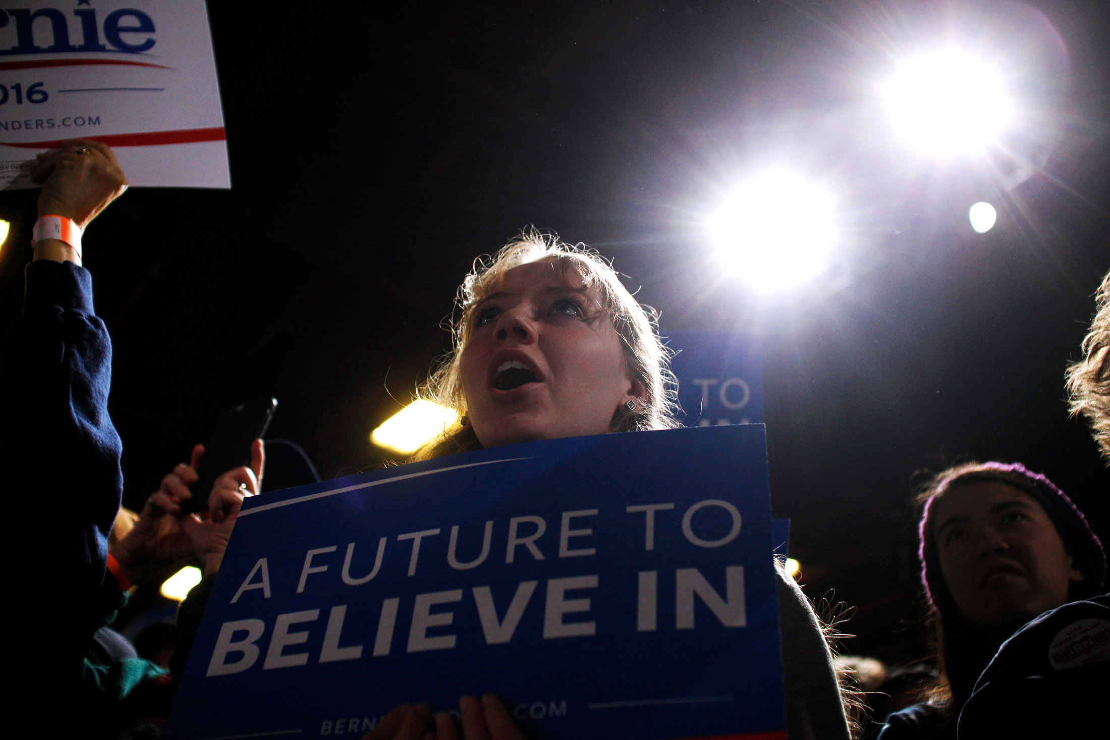 Supporters of Democratic presidential candidate Bernie Sanders waves signs and cheer while the candidate speaks at a Super Tuesday rally at the Champlain Valley Exposition in Essex Junction, Vermont on March 1, 2016.