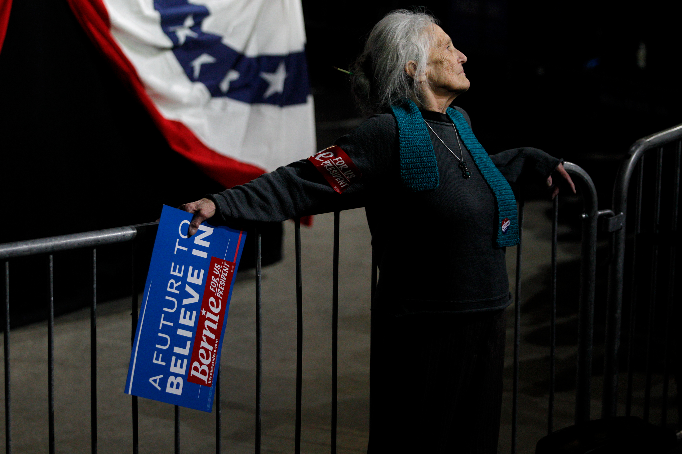 A supporter of Democratic presidential candidate Bernie Sanders leans against a security barrier while waiting on the candidate to arrive at a Super Tuesday rally at the Champlain Valley Exposition in Essex Junction, Vermont on March 1, 2016.