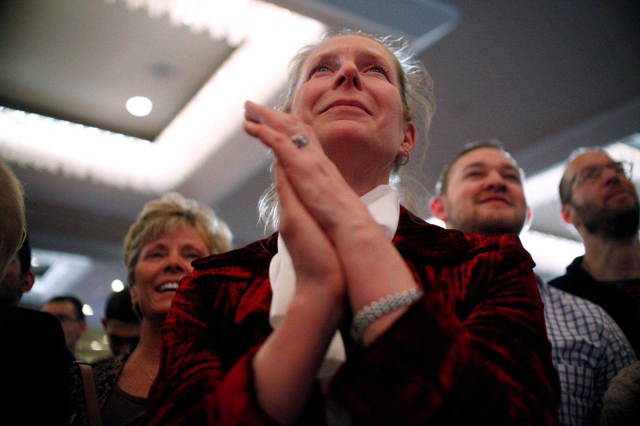A supporter of Republican presidential candidate Marco Rubio clasps her hands as she watches the candidate speak at a Primary night watch party at the Radisson in Manchester, New Hampshire on February 9, 2016. Early results showed Rubio finishing in fifth place in the nations first Presidential Primary.