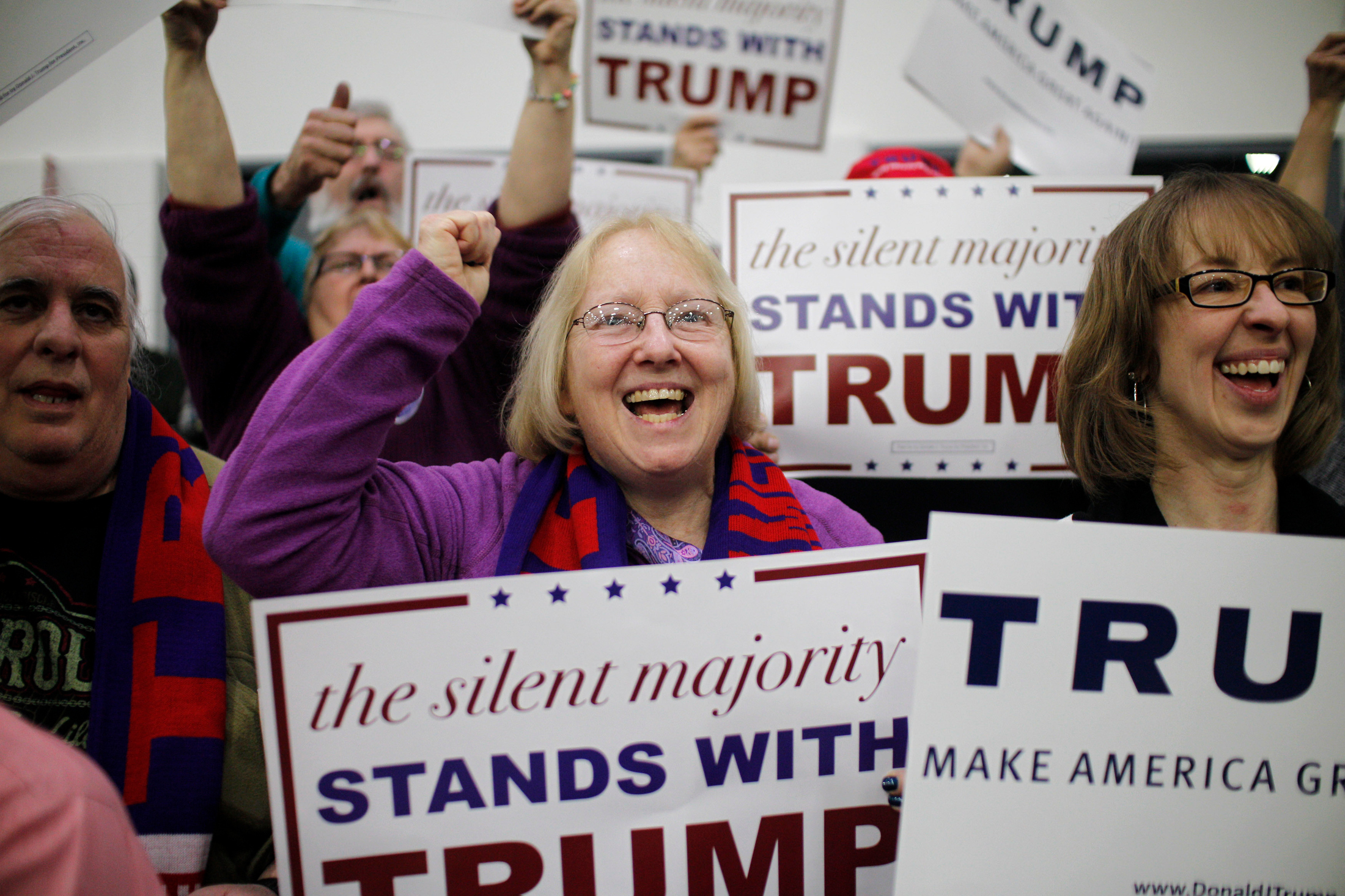 Supporters of Republican candidate for President Donald Trump cheer for the candidate before his arrival at a rally at Plymouth State University in Holderness, New Hampshire on February 7, 2016. New Hampshire will hold the first primary in the nation on February 9th.