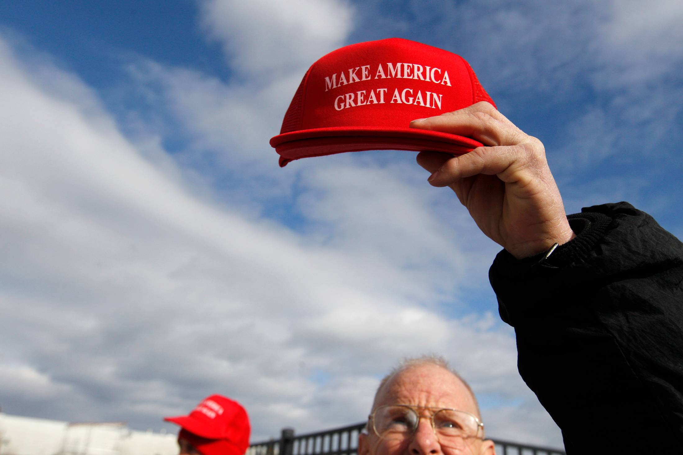 Robert Binington of Sarasota, Florida holds up a 'Make America Great Again' hat while selling paraphernalia in support of Republican candidate for president Donald Trump prior to a rally for Trump at Plymouth State University ALLWell North in Holderness, New Hampshire on February 7, 2016. New Hampshire will hold the first primary in the country on February 9th.