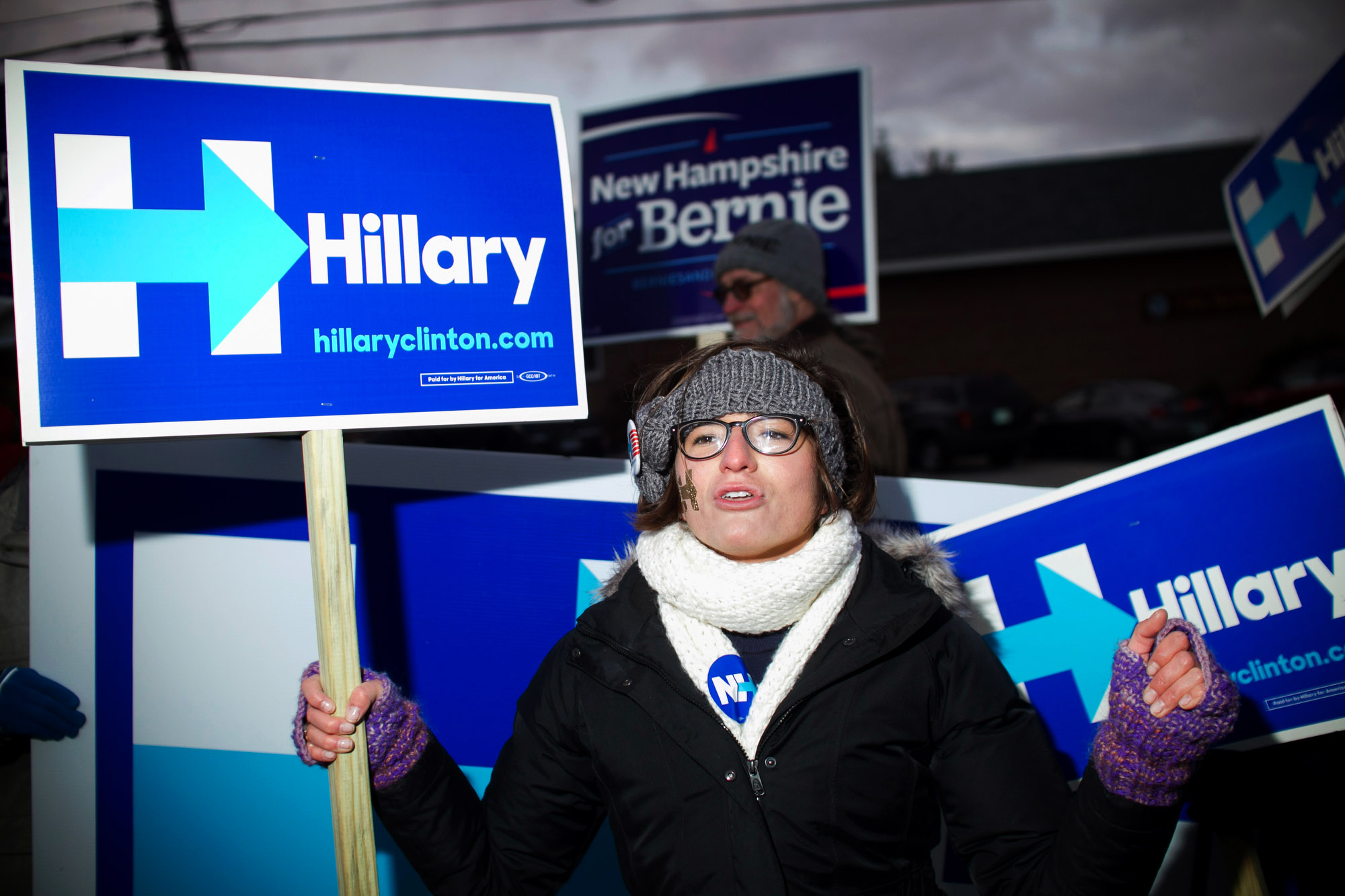 A woman chants to show her support for Democratic candidate for president Hillary Clinton, prior to a Democratic candidates debate at St. Anselm College in Manchester, New Hampshire on December 19, 2015. This will be the third Democratic debate.