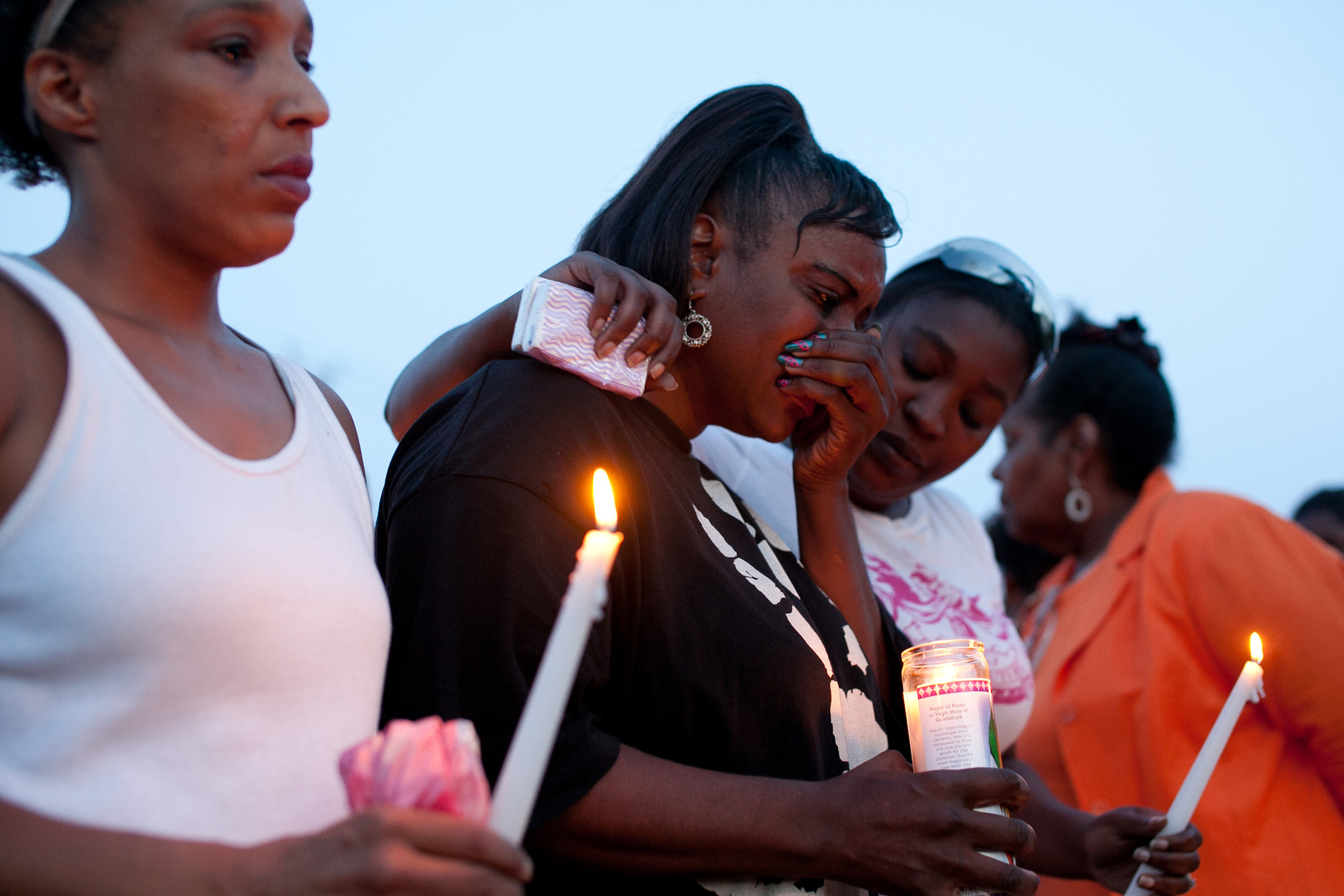 Friends of Marie Joseph from left Lisa Durban, Dee Reid, and Latish Price-Devoe console one another during a candlelight vigil for the drowning victim at the Vietnam Veterans Memorial Pool  on Friday July 1, 2011.