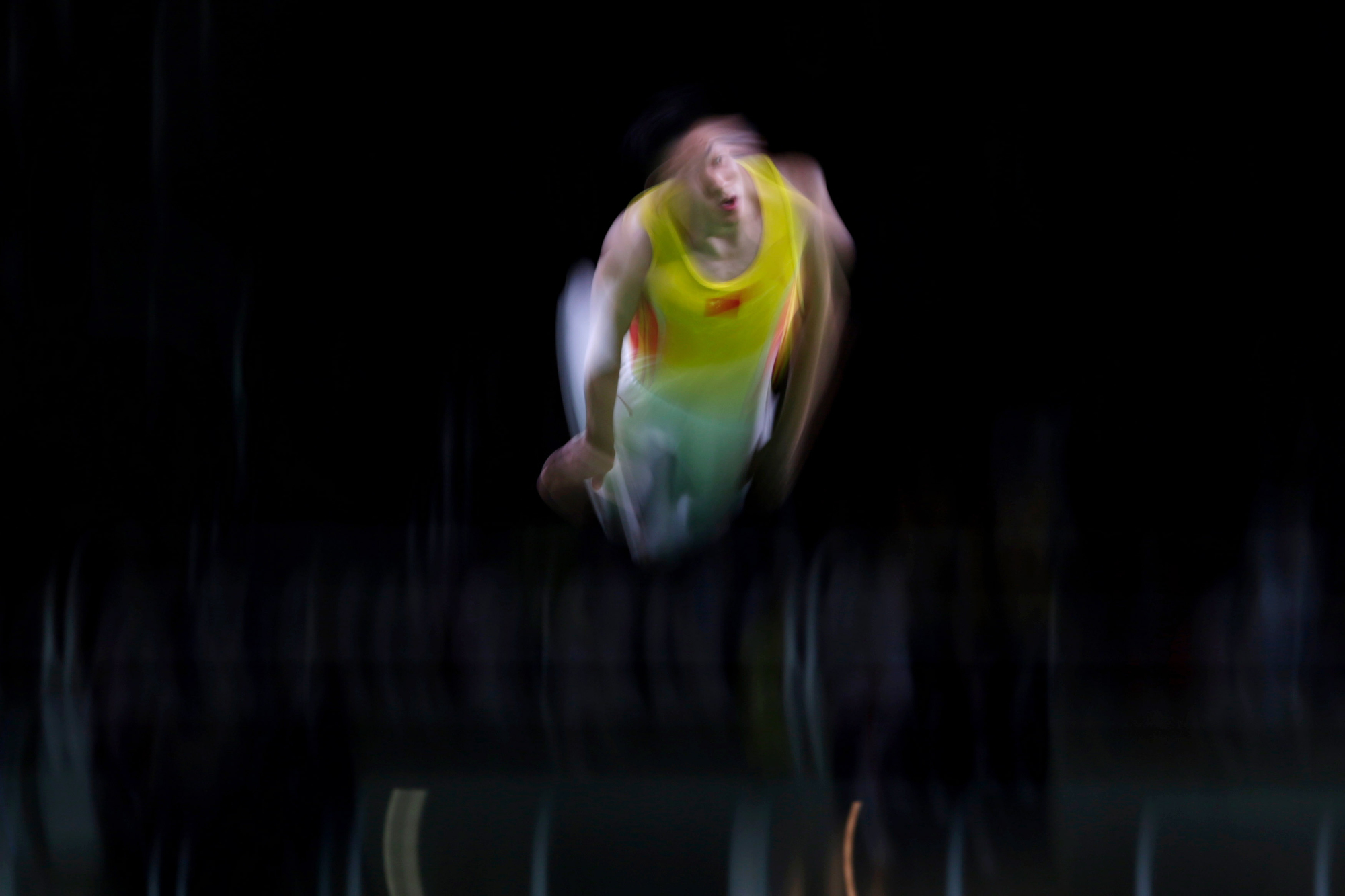 China's Dong Dong warms up before the Men's Trampoline Gymnastics finals in the Rio Olympic Stadium at the 2016 Rio Summer Olympics in Rio de Janeiro, Brazil, on August 13, 2016.