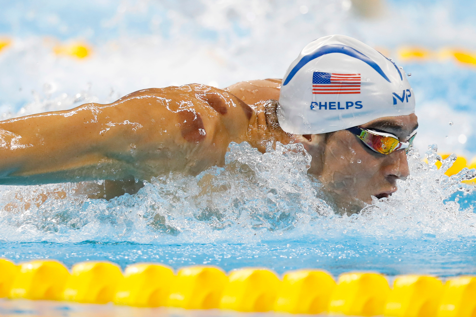 America's Michael Phelps competes in the third Men's 200M Butterfly heat at the Olympic Aquatics Stadium at the 2016 Rio Summer Olympics in Rio de Janeiro, Brazil, on August 8, 2016. Phelps finished third with a time of 1:55.73.