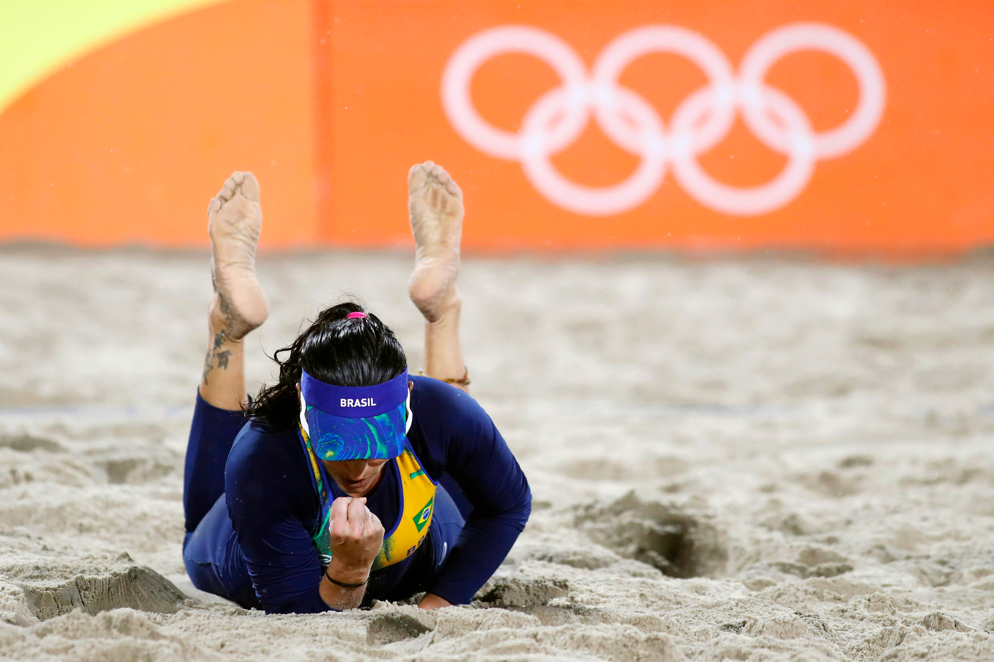 Brazil's Ágatha Bednarczuk lays in the sand after missing a dig against Spain during a Women's Beach Volleyball preliminary match at the 2016 Rio Summer Olympics on Copacabana Beach in Rio de Janeiro, Brazil, on August 10, 2016. Spain defeated Brazil 2-0.