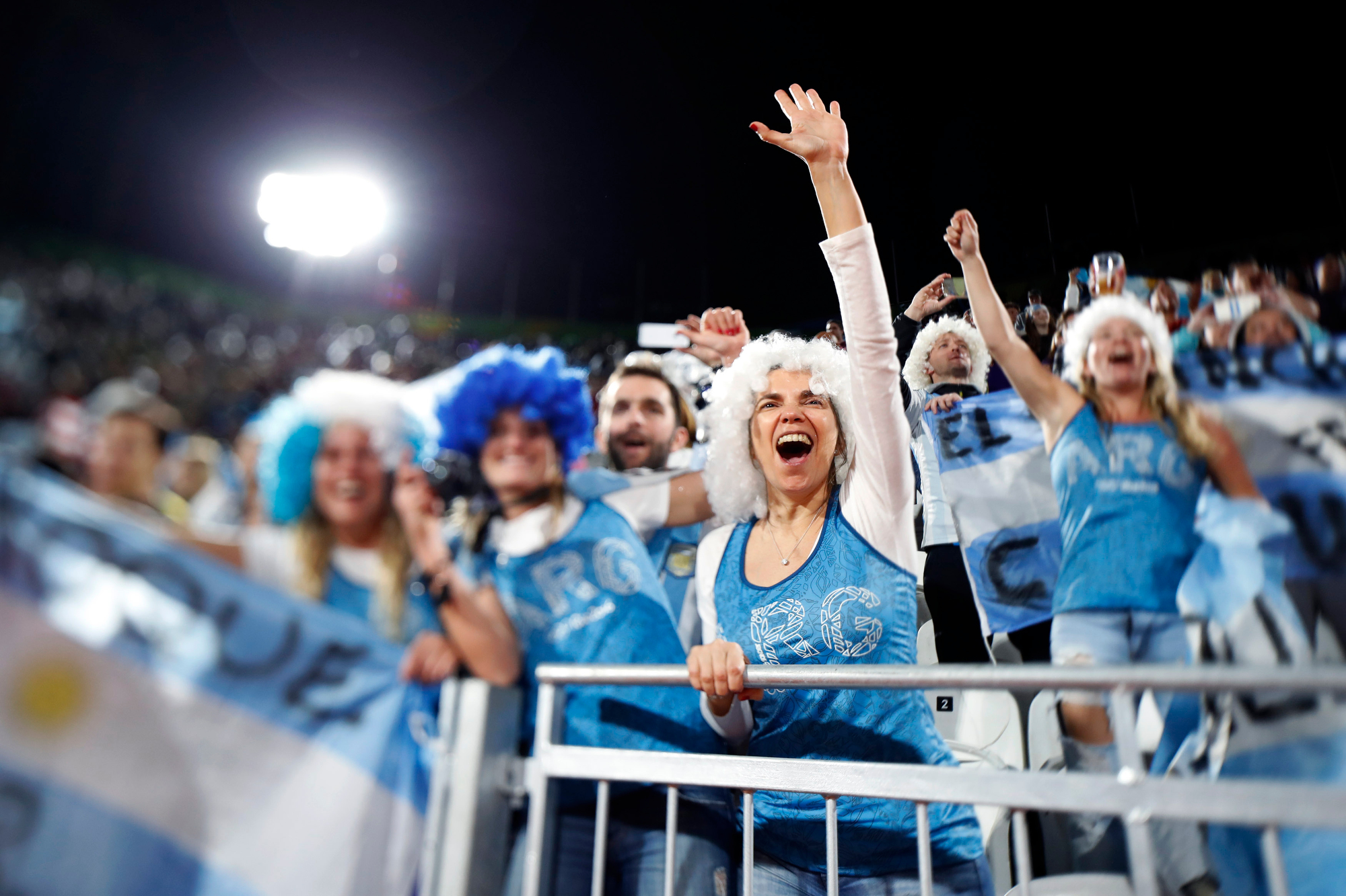 Argentina fans cheer for their team before taking on the Czech Republic in a Women's Beach Volleyball preliminary match at the 2016 Rio Summer Olympics on Copacabana Beach in Rio de Janeiro, Brazil, on August 10, 2016.