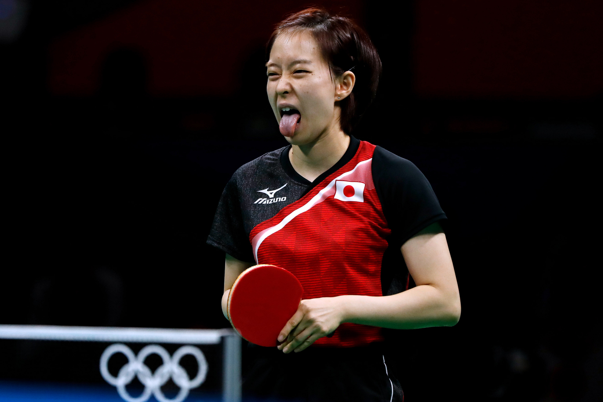 Japan's Kasumi Ishikawa reacts during a match against Singapore's Tianwei Feng in the Women's Team Table Tennis bronze medal match in Riocentro Pavilion 3 at the 2016 Rio Summer Olympics in Rio de Janeiro, Brazil, on August 16, 2016. Japan clinched the bronze in four matches.