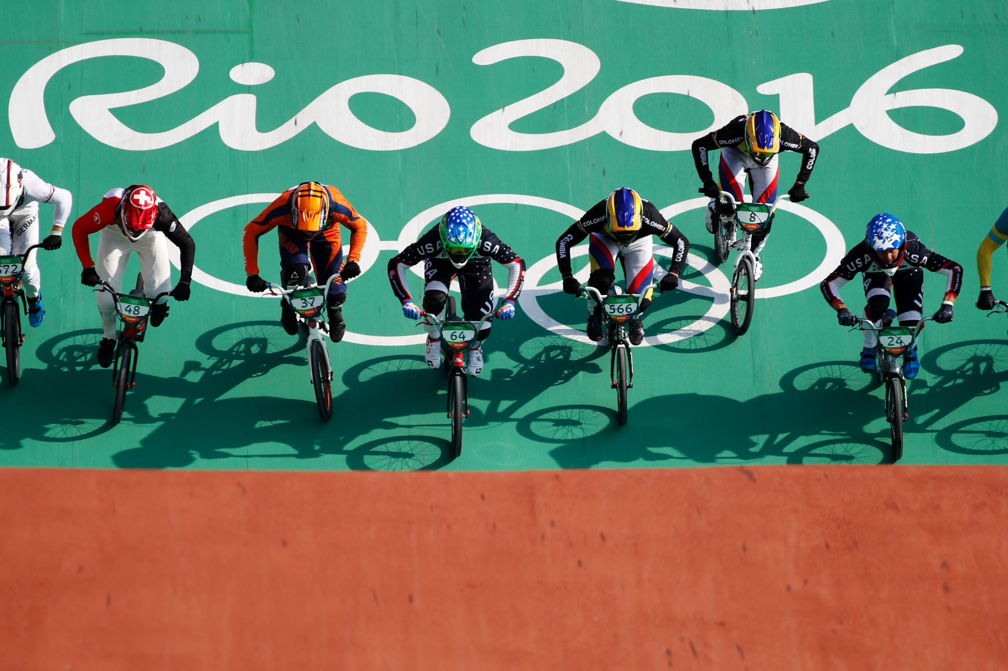Riders speed down the starting ramp in a Men's BMX Cycling semifinal in the Olympic BMX Centre at the 2016 Rio Summer Olympics in Rio de Janeiro, Brazil, on August 19, 2016.