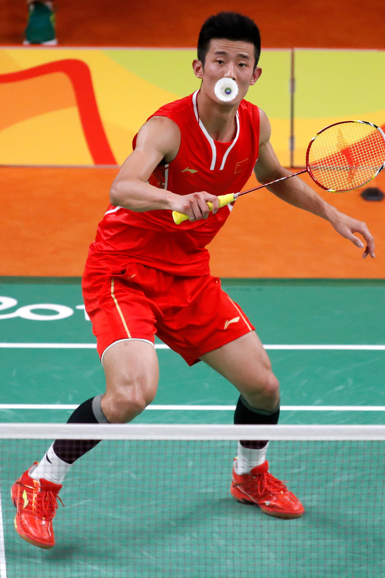China's Long Chen takes on Malaysia's Chong Wei Lee (not pictured) in the Men's Badminton Singles gold medal match at the 2016 Rio Summer Olympics in Rio de Janeiro, Brazil, on August 20, 2016. Chen defeated Lee to win the gold medal.