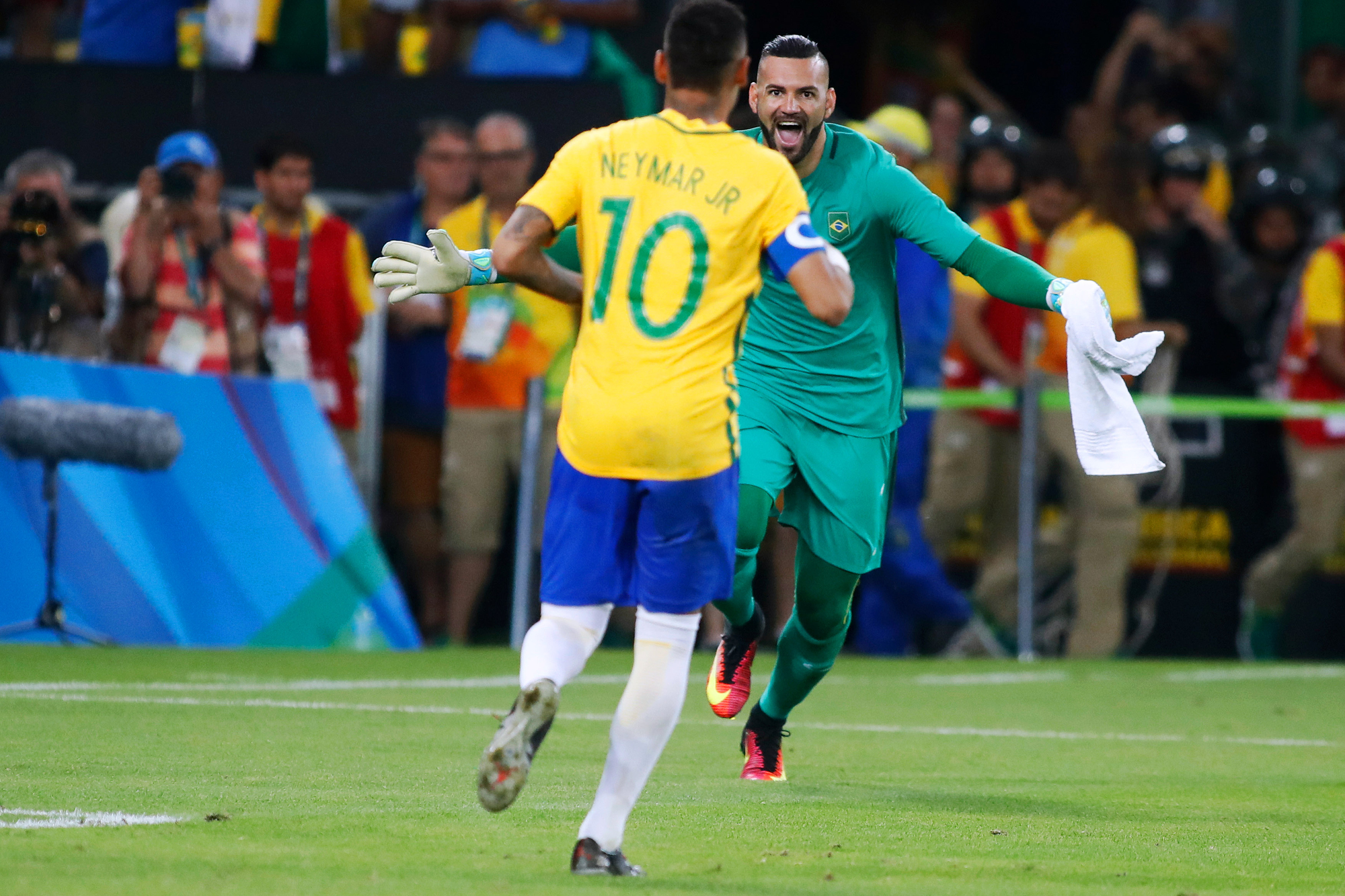 Brazil forward Neymar (10) charges towards goaltender Waverton (1) after Neymar scored the game winning goal in an overtime shoot-out against Germany in the Men's Gold Medal soccer match at the 2016 Rio Summer Olympics in Rio de Janeiro, Brazil, on August 20, 2016. Brazil defeated Germany in 5-4 in overtime penalty kicks.