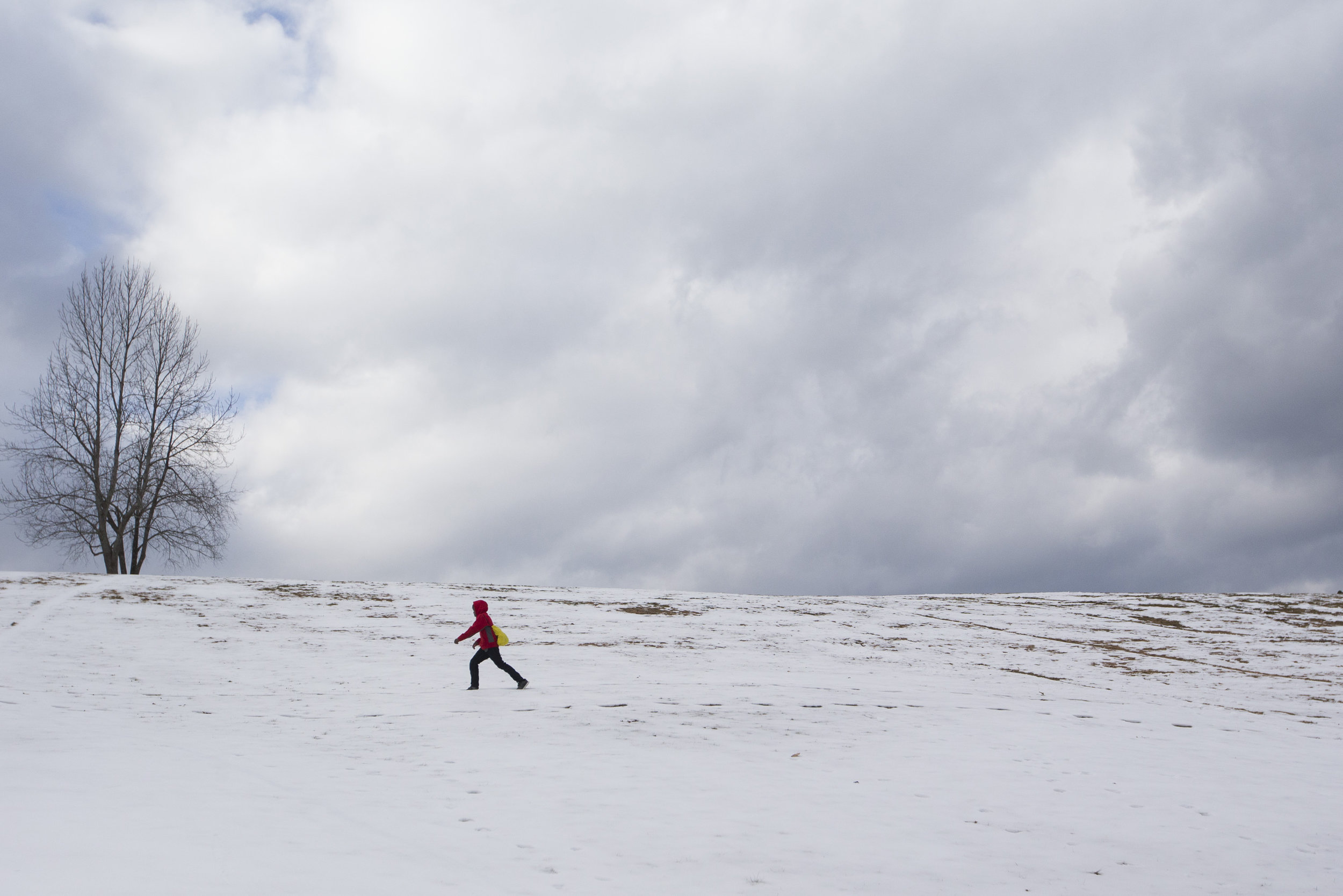 Edward Boderbe, 9 of Worcester, trudges across a snow covered hill after playing soccer in Green Hill Park on January 29, 2017 in Worcester, Massachusetts
