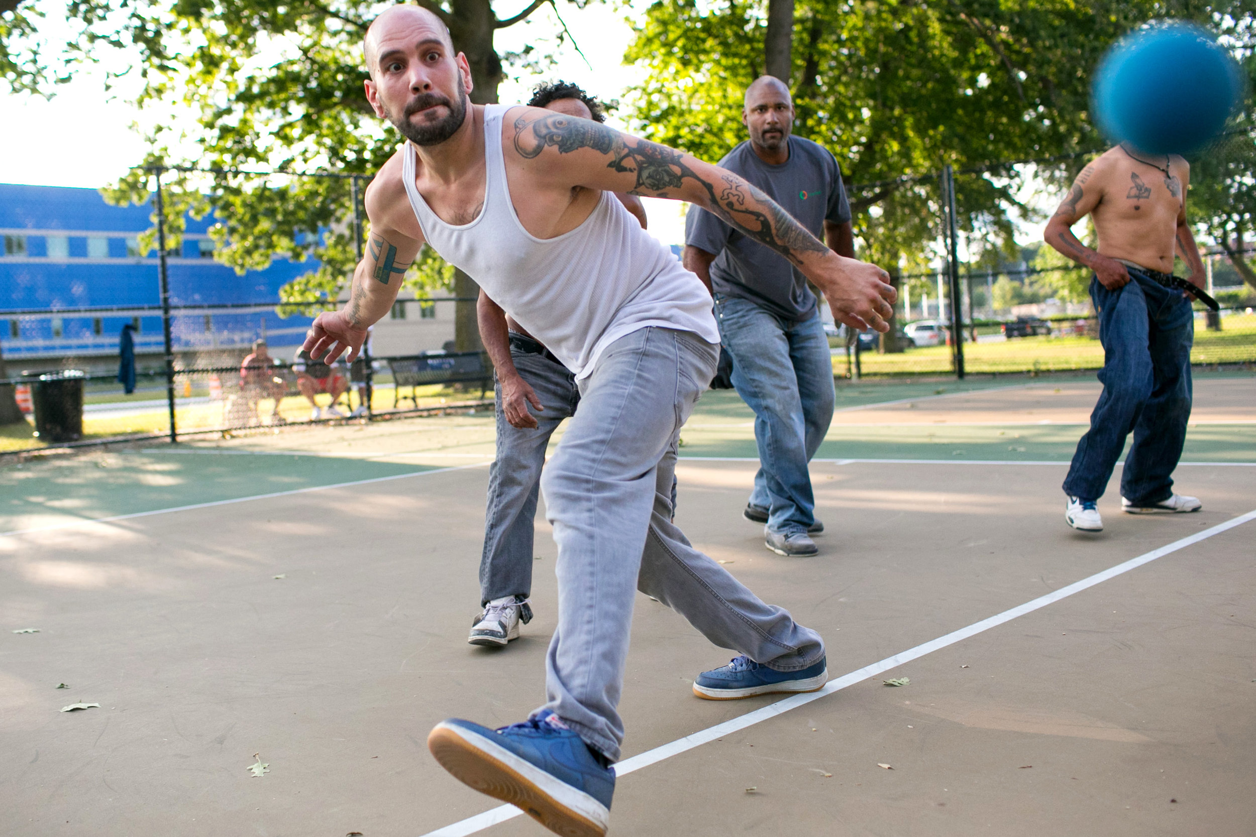 Wilson Montalvo (L) of Worcester chases after the ball during a game of handball with Jose Lopez (2nd-L), Raul Vazquez (2nd-R) and Steven Ramsey (R) at Crompton Park in Worcester, Massachusetts on August 24, 2017.