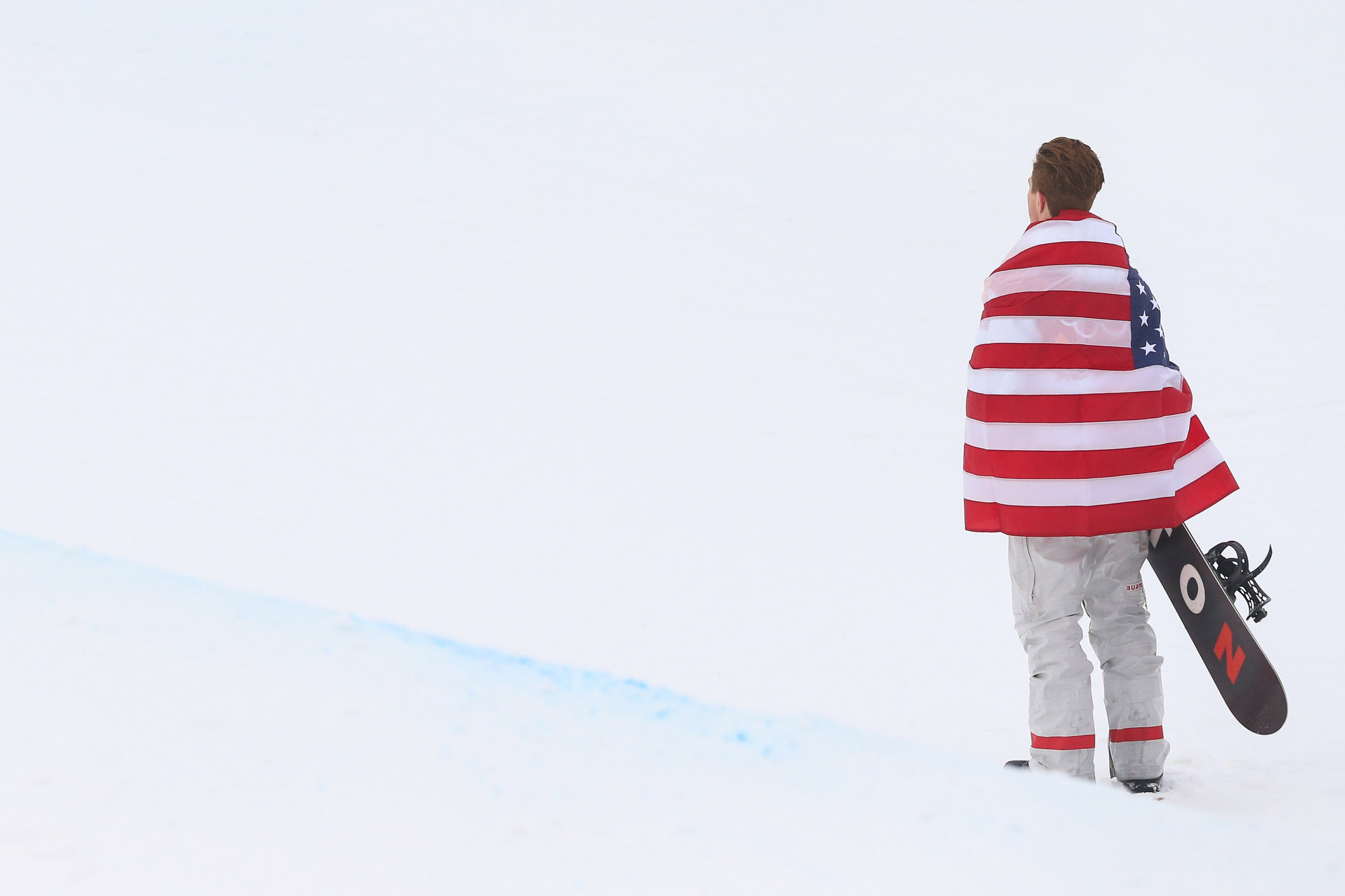 Shaun White of the United States looks up at the halfpipe while posing for a photo after winning the gold medal in the Men's Halfpipe finals at the 2018 Pyeongchang Winter Olympics at Phoenix Snow Park in Pyeongchang, South Korea, on February 14, 2018. White took gold in the event with a best score of 97.75. Photo by Matthew Healey/UPI