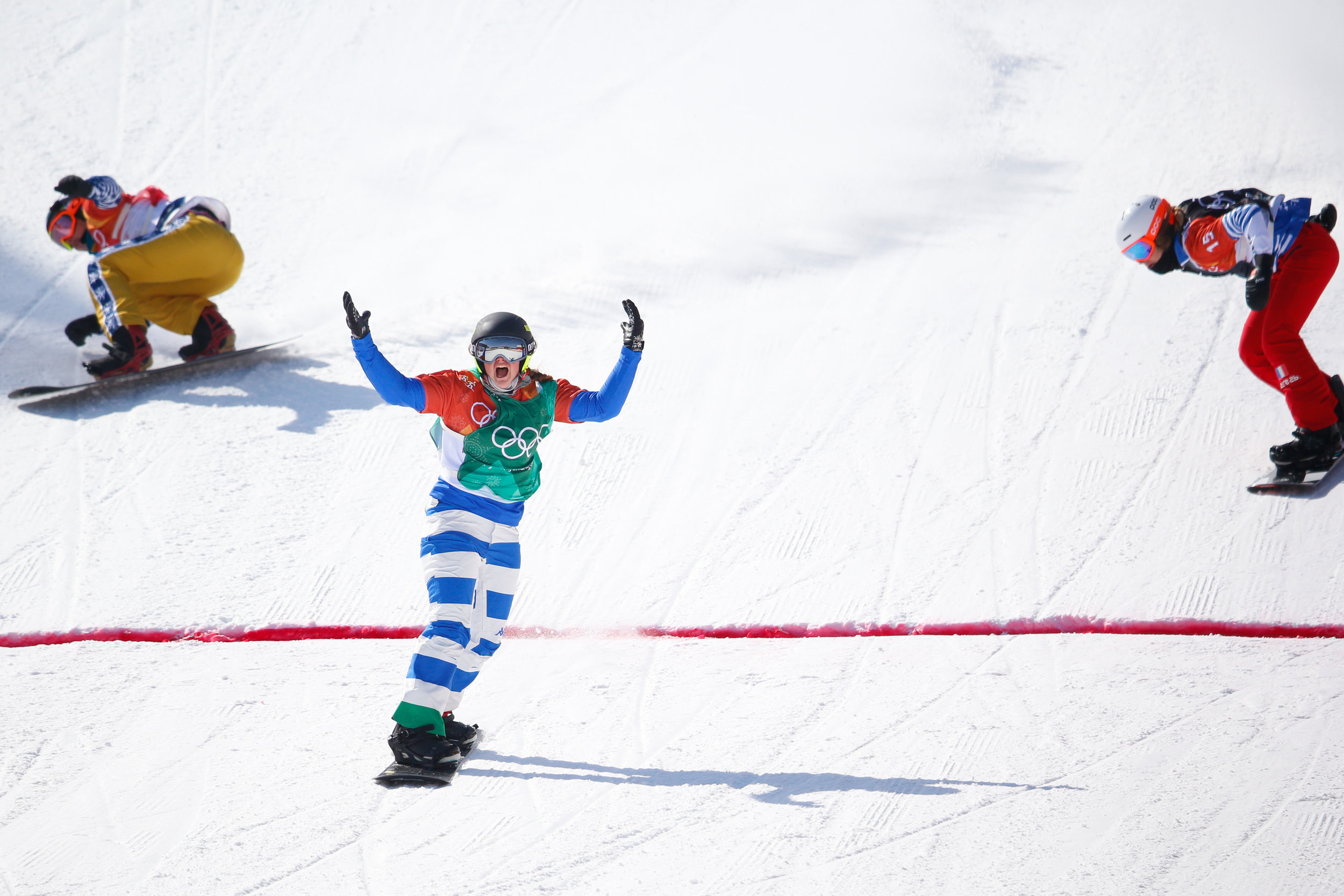 From left Eva Samkova of the Czech Republic, Michela Moioli of Italy, Julia Pereira de Sousa Mabileau of France, cross the finish line in the Ladies' Snowboard Cross big final at Phoenix Snow Park in Pyeongchang, South Korea on February 16, 2018. Moioli took gold in the event with Pereira de Sousa Mabileau and Samkova taking silver and bronze respectively. Photo by Matthew Healey/UPI