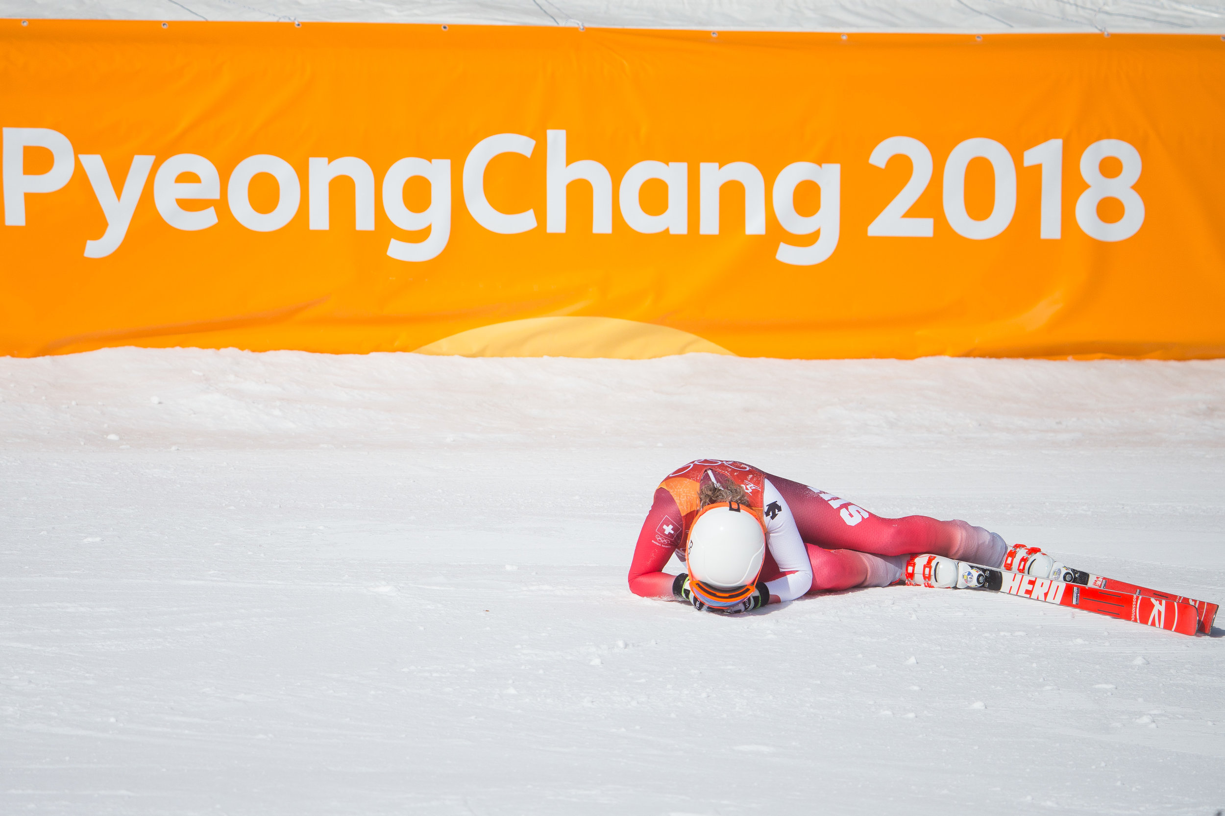 Michelle Gisin of Switzerland lays in the snow after sliding across the finish line of the Ladies' Downhill final at Jeongseon Alpine Center in Pyeongchang, South Korea on February 21, 2018. Photo by Matthew Healey/UPI