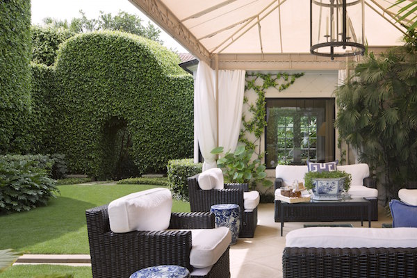 Howard Slatkin famous for his fabulous candles opts for a more contemporary formal terrace -reminds me of East Hampton.