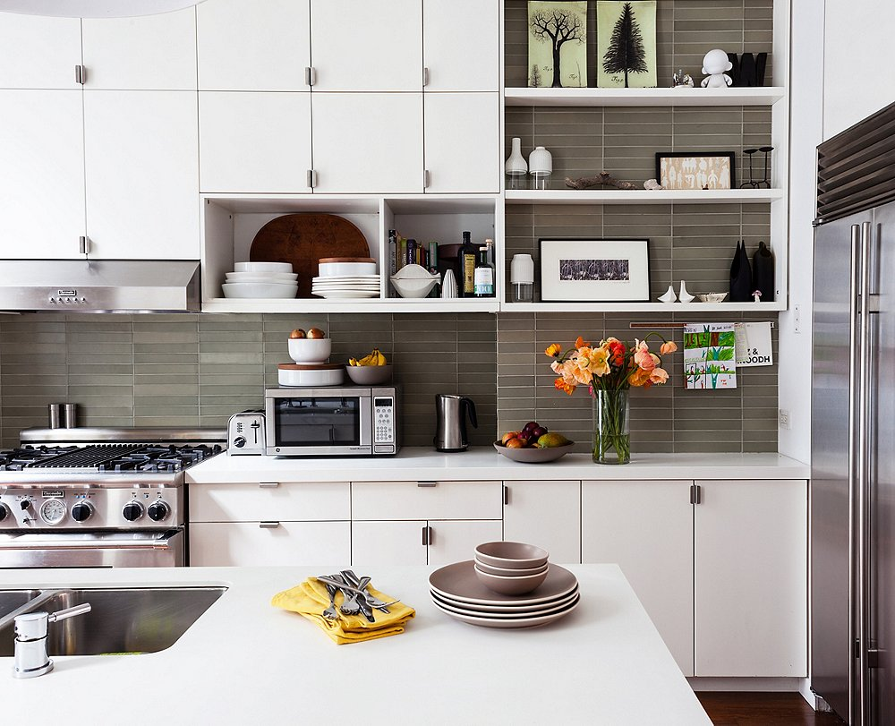 This layout offers the best of both worlds with open shelving and cabinets -the grey tiled baksplash saves the whole look from being too sterile.