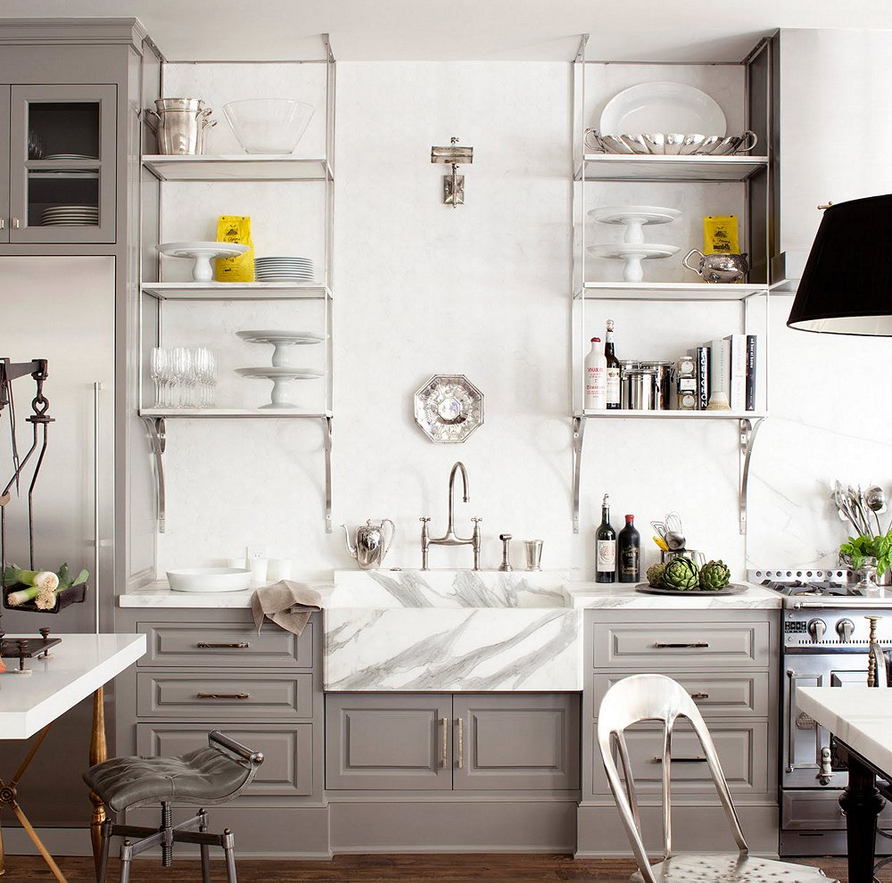 Really like the mix of metal finishes, painted cabinetry and the dramatically veined farmhouse sink.