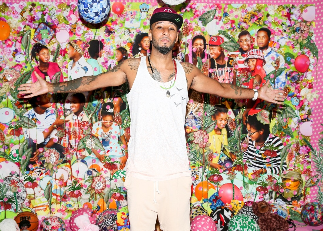 """Swizz Beatz poses in front of a wall mural by the uber talented Ebony G Patterson at """"No Commission"""" -  Photo by   Angela Pham"""