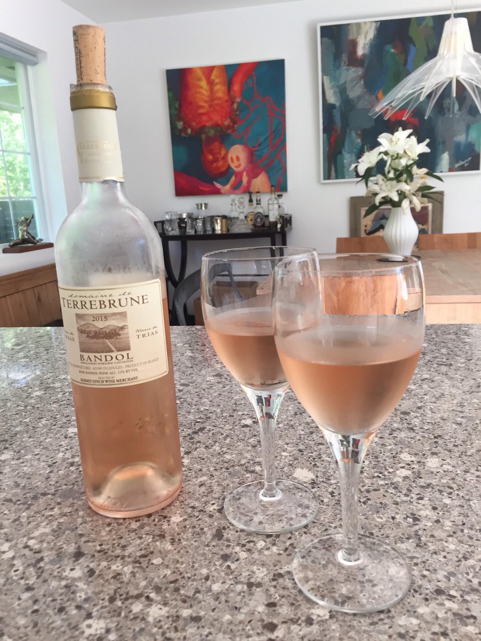 Relaxing by Phyllis's pool in Bridgehampton was the perfect setting for sampling rosés and we loved this one - medium dry, light fruit notes,floral bouquet and such a pretty color!