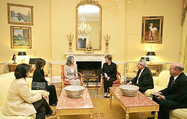 Mrs Laura Bush entertaining guests in the Yellow Oval Room...historically this room's always been yellow - the two coffee tables seem a little out of scale in the room