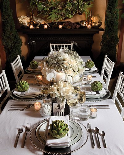 I love this nod to minimalism with the beautiful artichokes as the centerpiece on each plate - the full-on tablescape in this setting sits on the console instead of the dining table